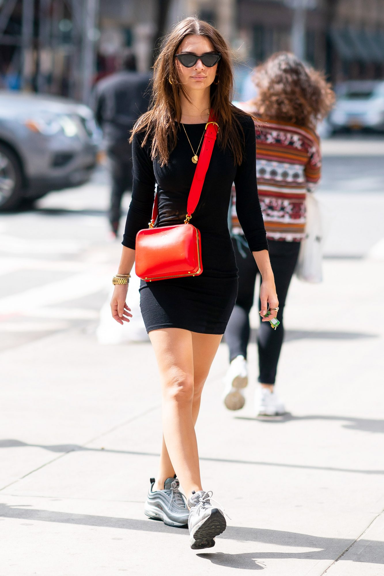 EXCLUSIVE: Emily Ratajkowski wears a little black dress with a Mark Cross handbag while out for a stroll in New York City
