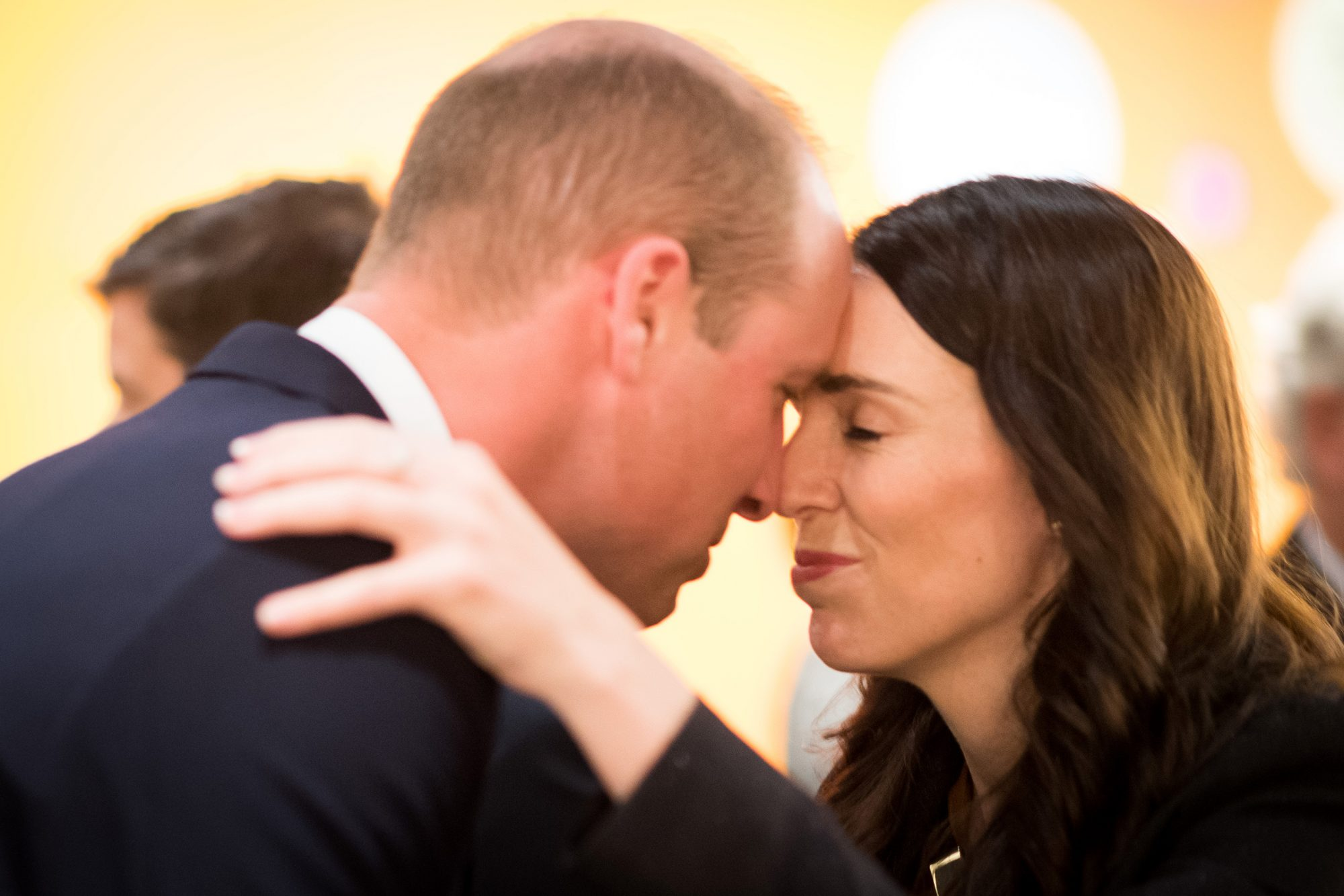 Prince William is greeted with a Hongi, a traditional Maori greeting, by Prime Minister Jacinda Ardern