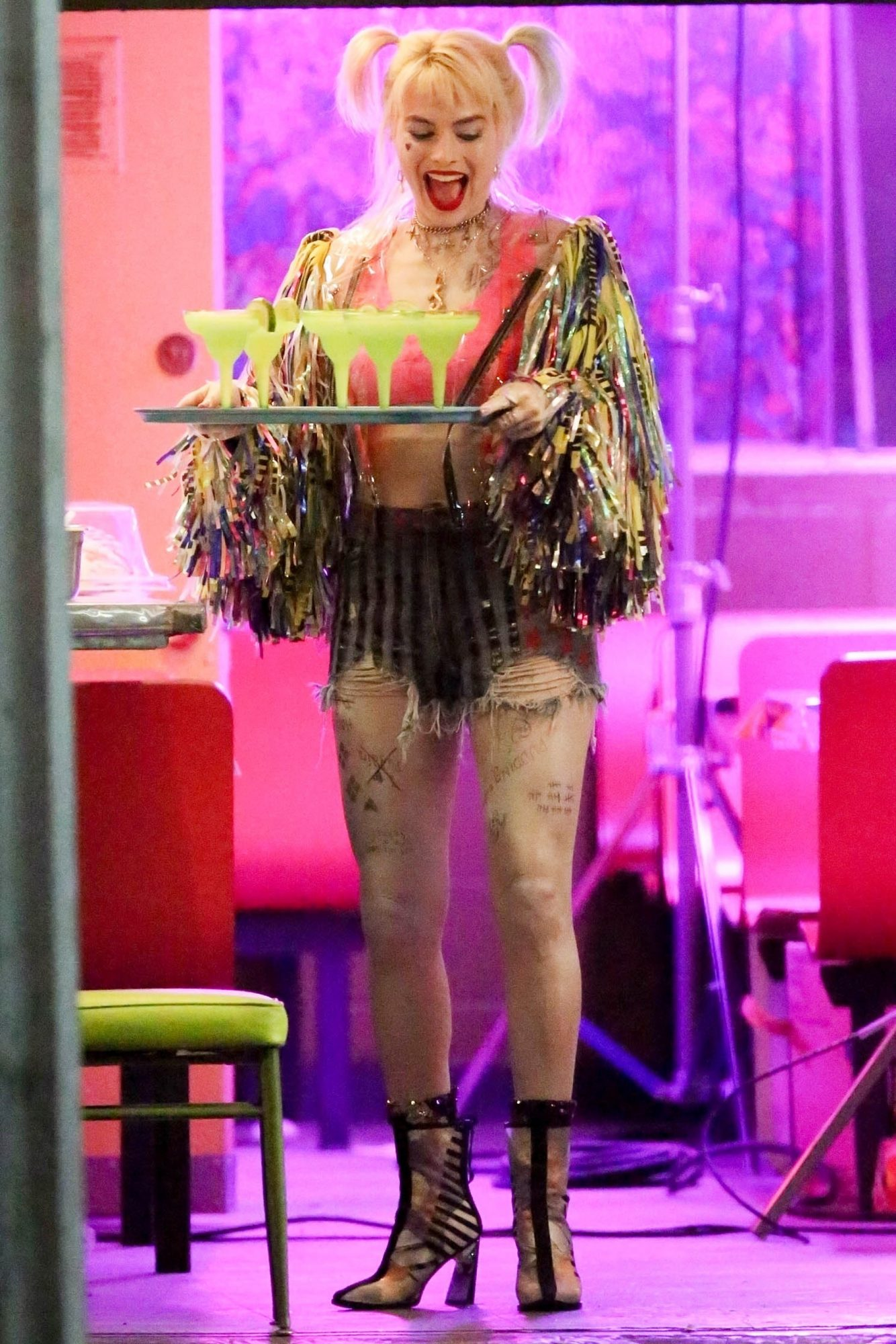 Margot Robbie brings Harley Quinn to the party as she serves up margaritas in Los Angeles, CA