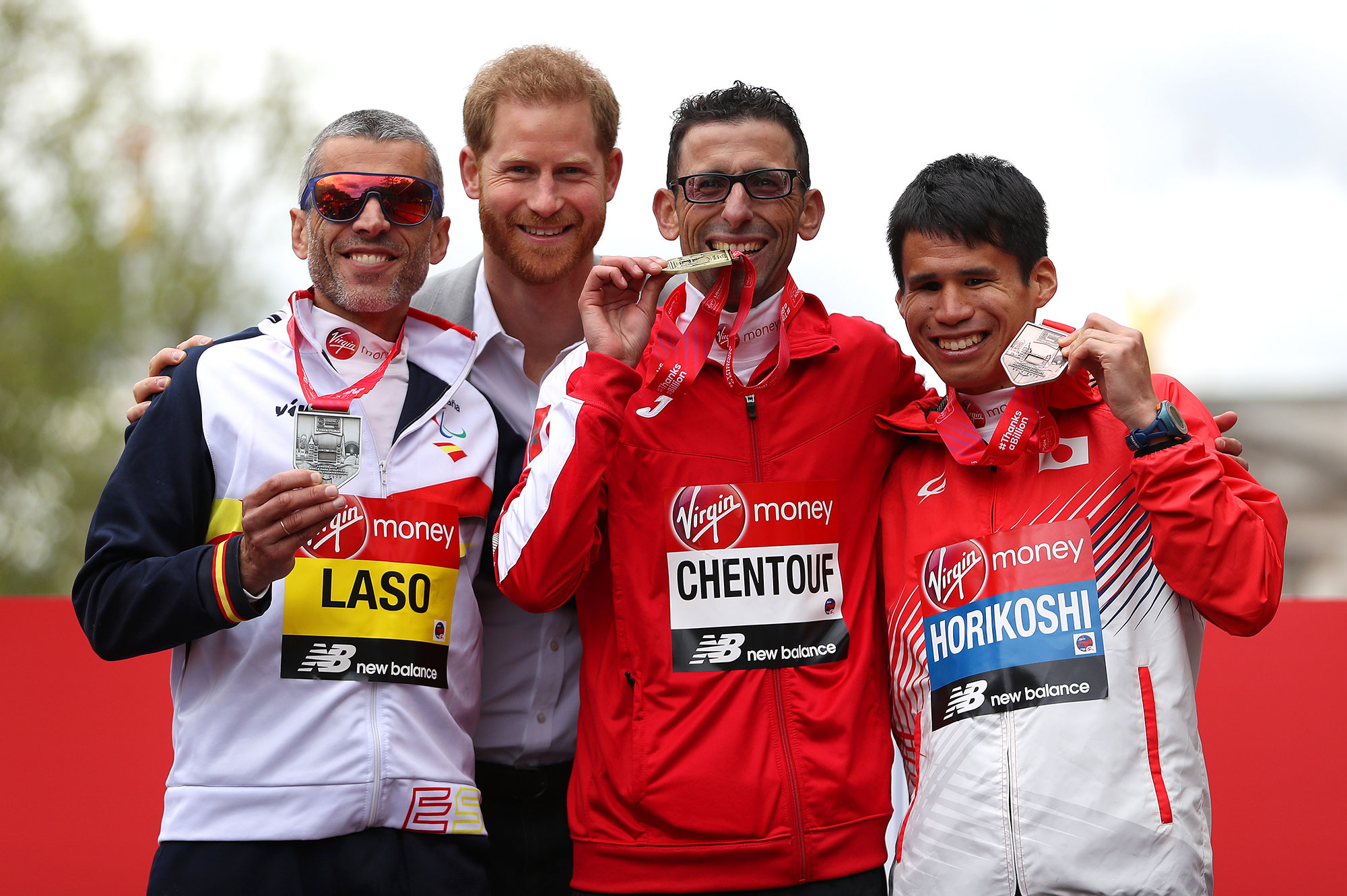 LONDON, ENGLAND - APRIL 28: Alberto Suarez Laso of Spain (2nd), El Amin Chentouf of Morocco (1st) and Tadashi Horikoshi of Japan celebrate their respective finishing positions in the T12 Men's race with Prince Harry,