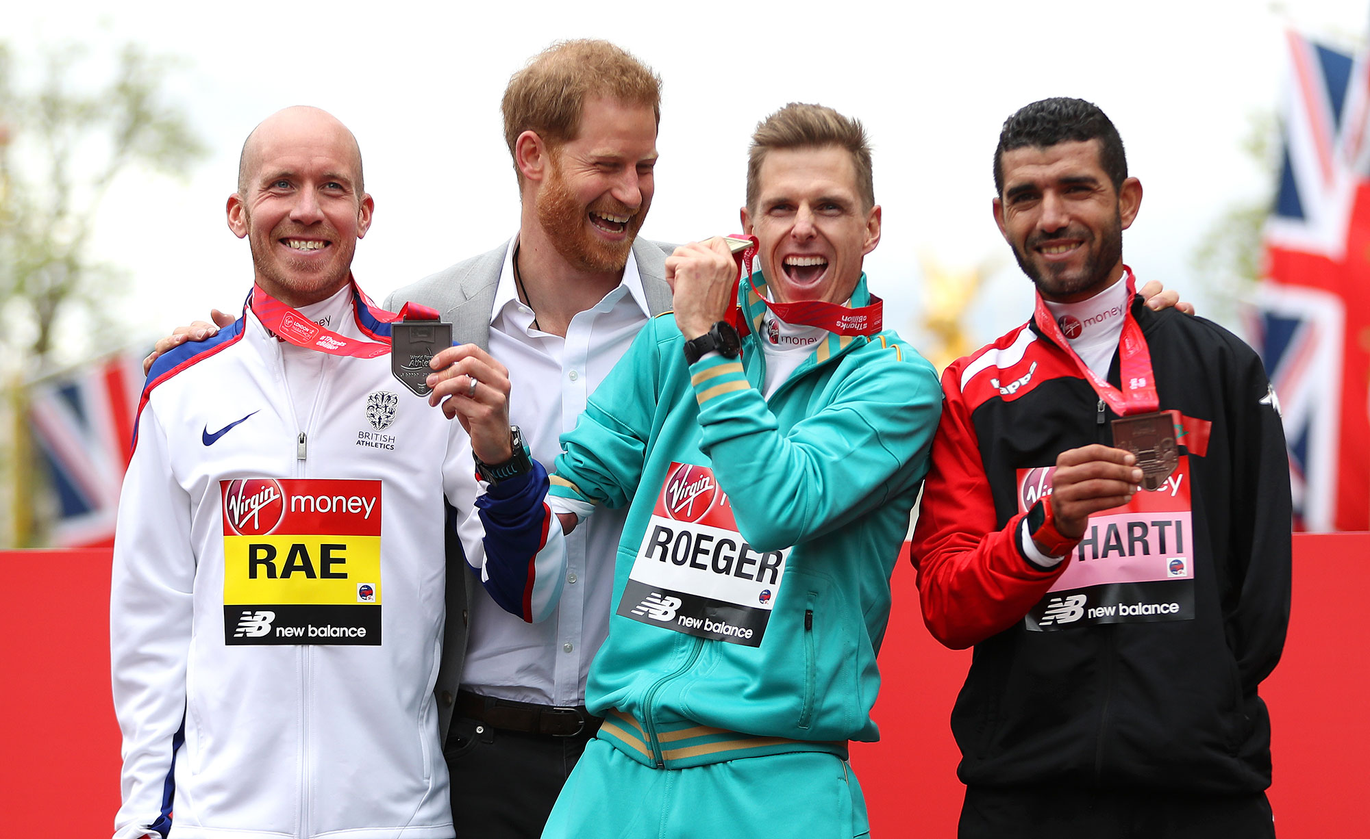 Derek Rae of Great Britain (2nd), Michael Roger of Australia (1st) and Abdehadi El Harti of Morocco (3rd) all celebrate their respective finishing positions in the T46 Men's race with Prince Harry, Duke of Sussex