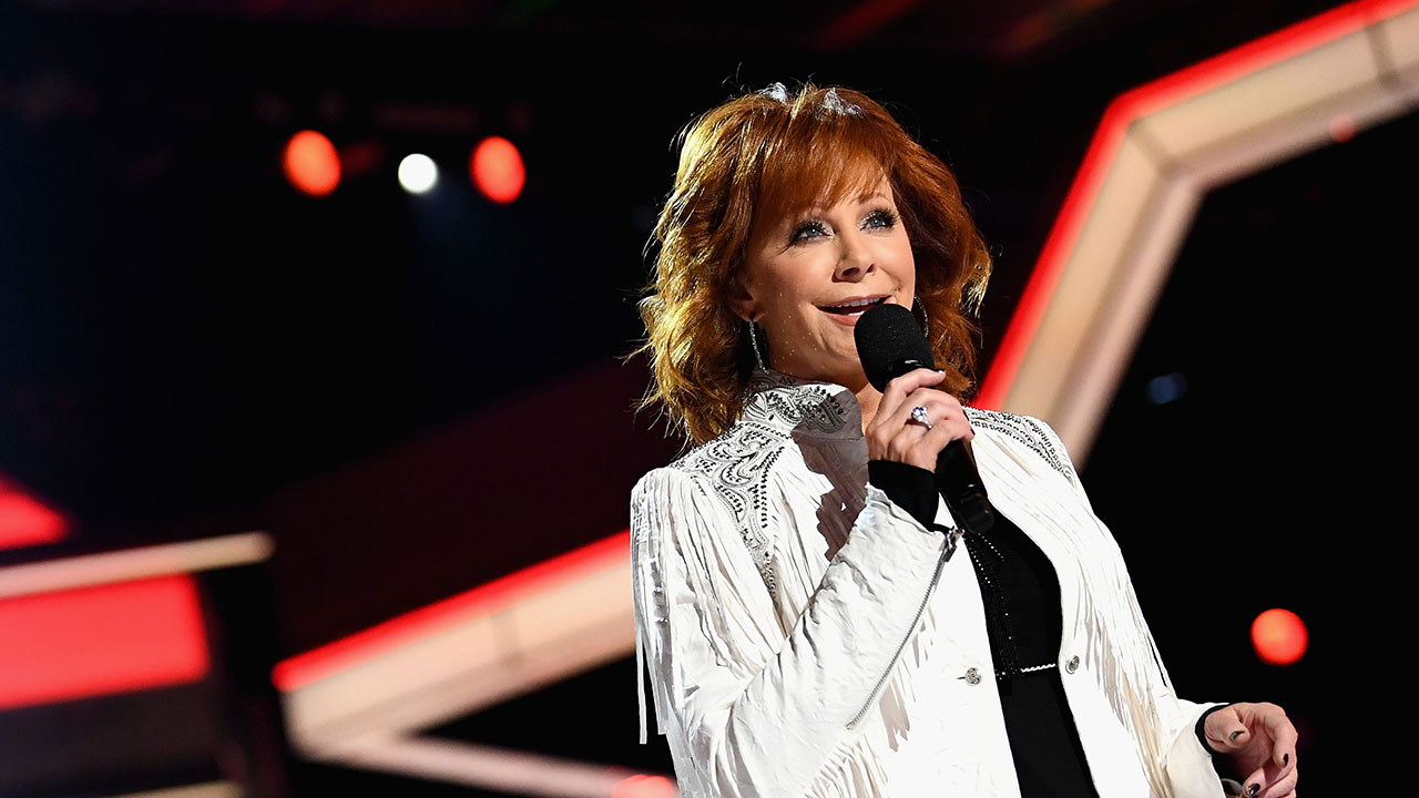 After hosting the ACM Awards 16 times, Reba has so many outfits to look back on