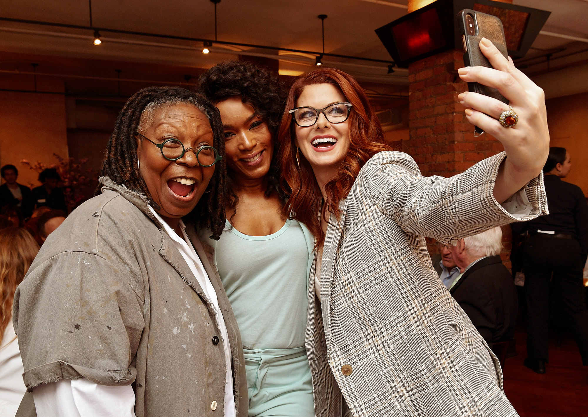 Whoopi Goldberg, Angela Bassett, and Debra Messing