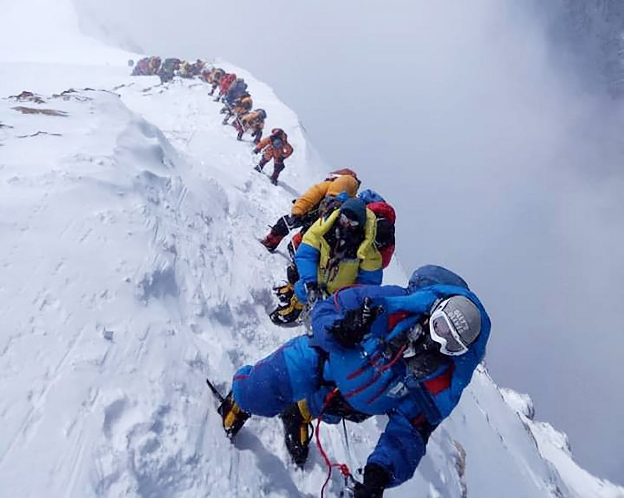 In this photo taken on May 16, 2018, mountaineers ascend on their way to the summit of Mount Everest, as they climb on the south face from Nepal.
