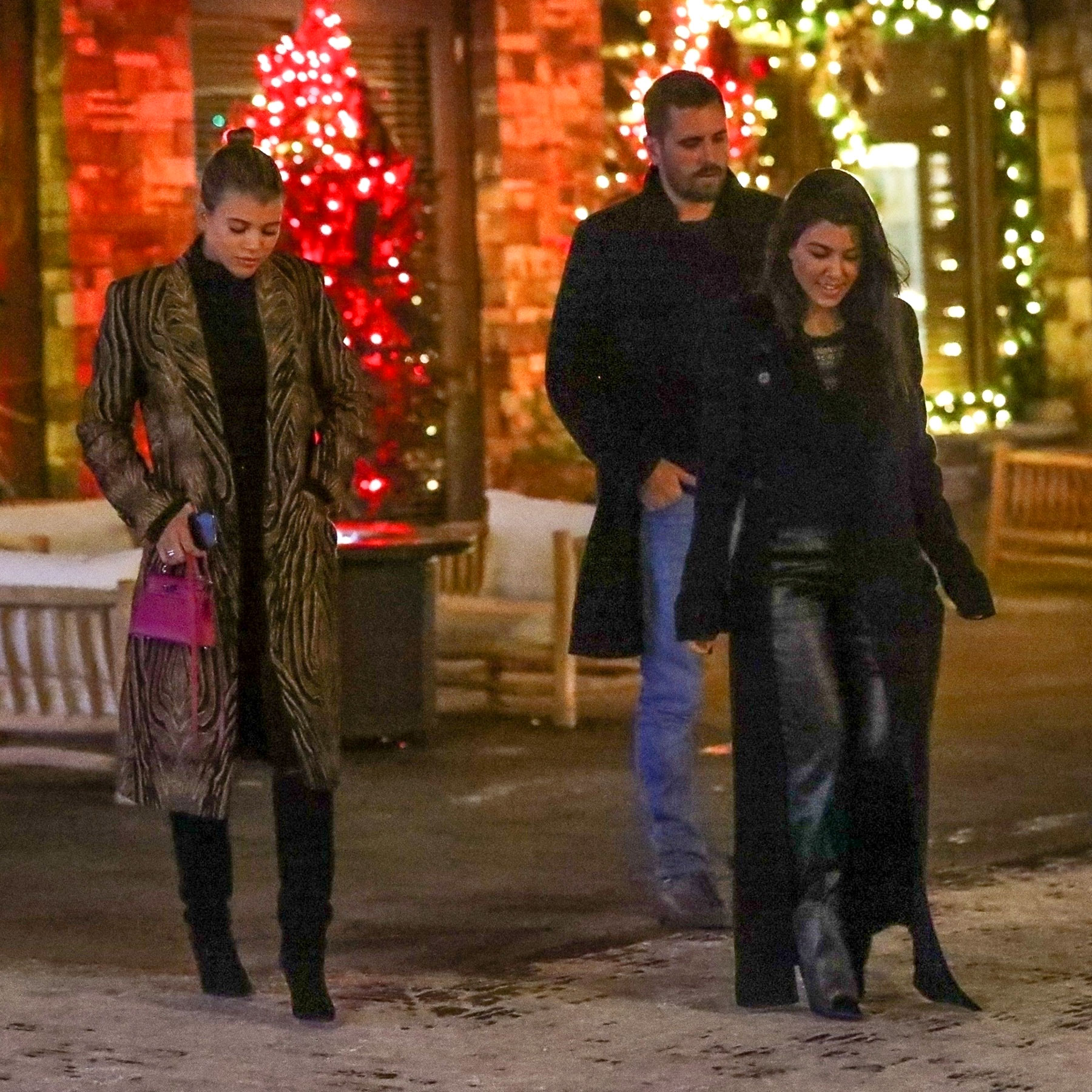 *EXCLUSIVE* Kourtney Kardashian takes on cold Aspen winds with see through top while out with Scott and Sofia