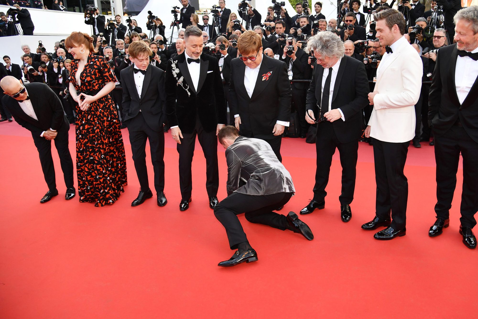 Taron Egerton fixes Elton John's pants as they arrive for the screening of 'Rocketman' during the 72nd annual Cannes Film Festival, in Cannes, France, 16 May 2019.