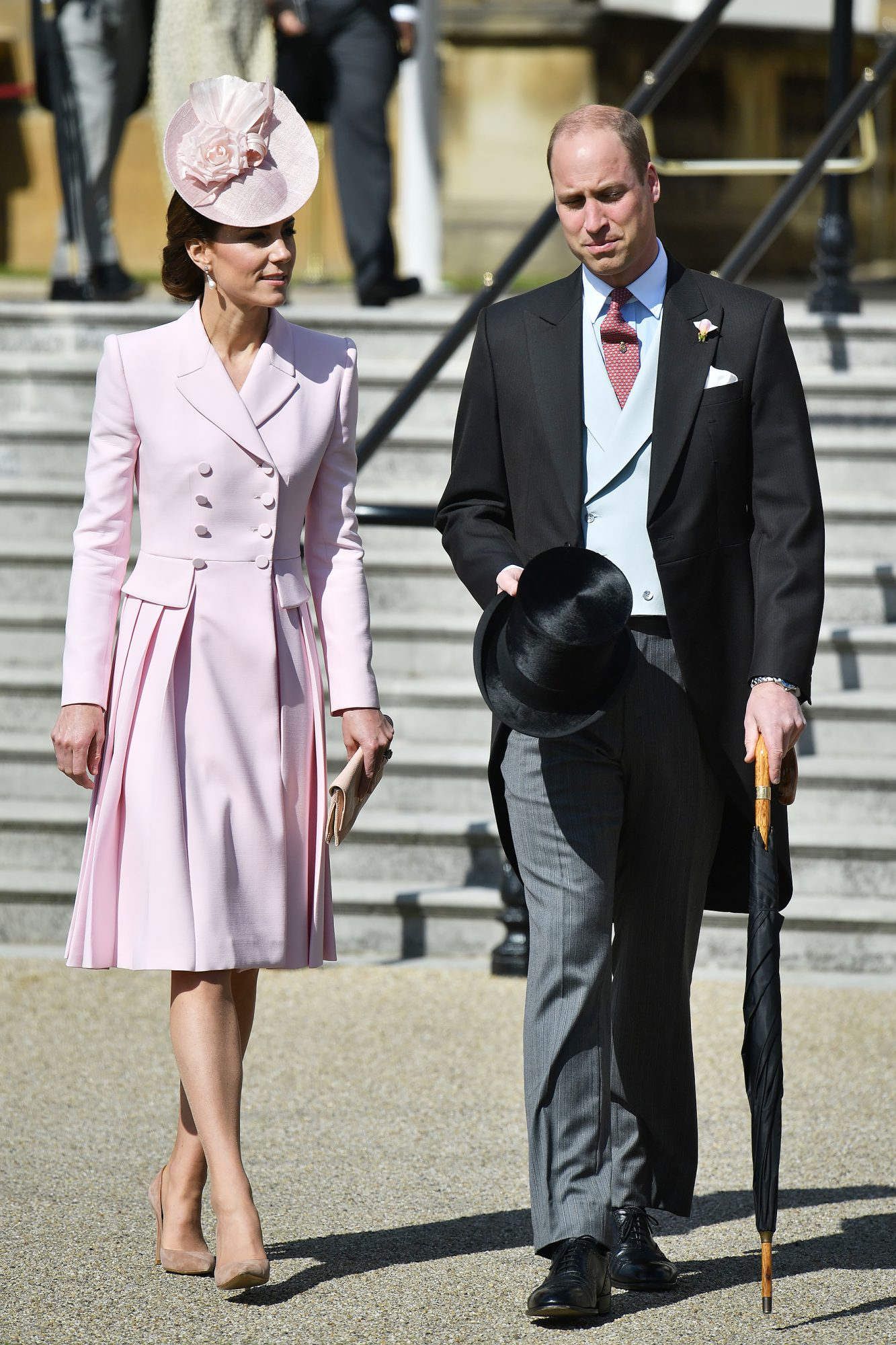 Britain's Prince William, Duke of Cambridge and Britain's Catherine, Duchess of Cambridge attend the Queen's Garden Party at Buckingham Palace in central London on May 21, 2019