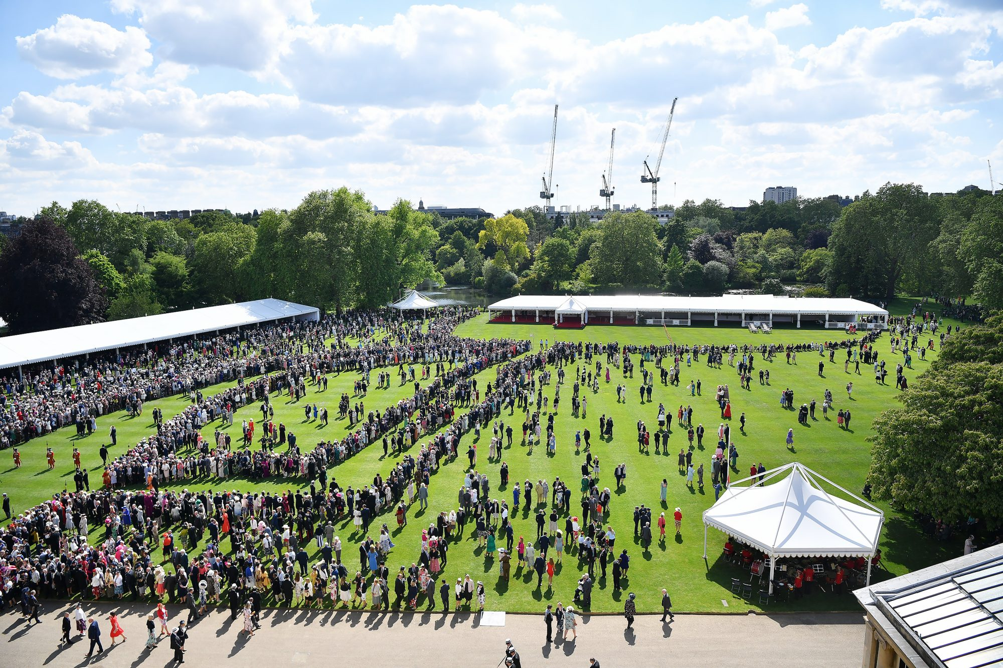 Guests attend a garden party in teh grounds of Buckingham Palace in central London on May 21, 2019