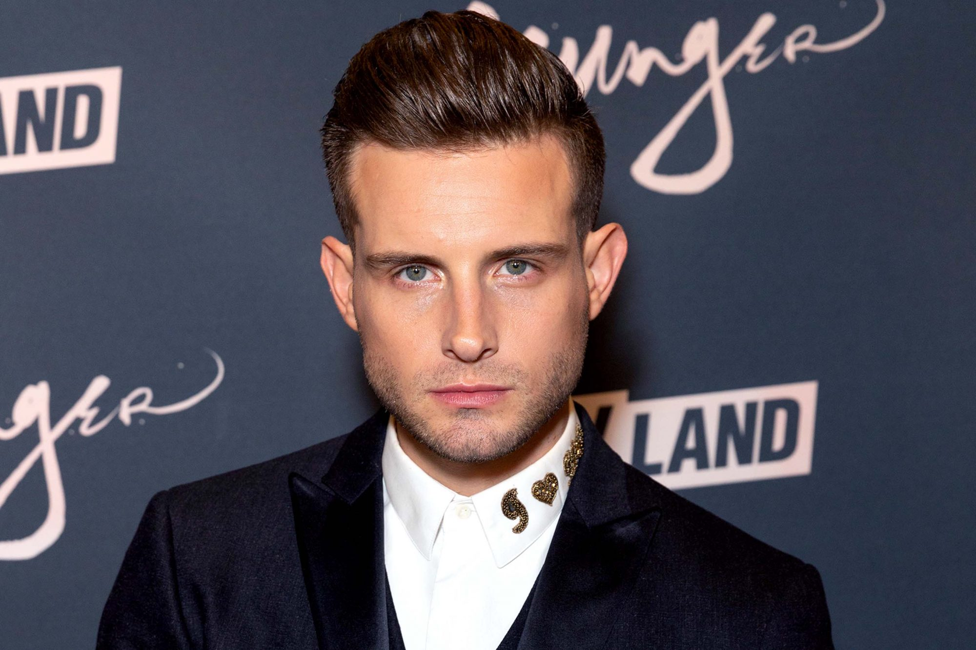 Nico Tortorella wearing suit by John Varvatos attends