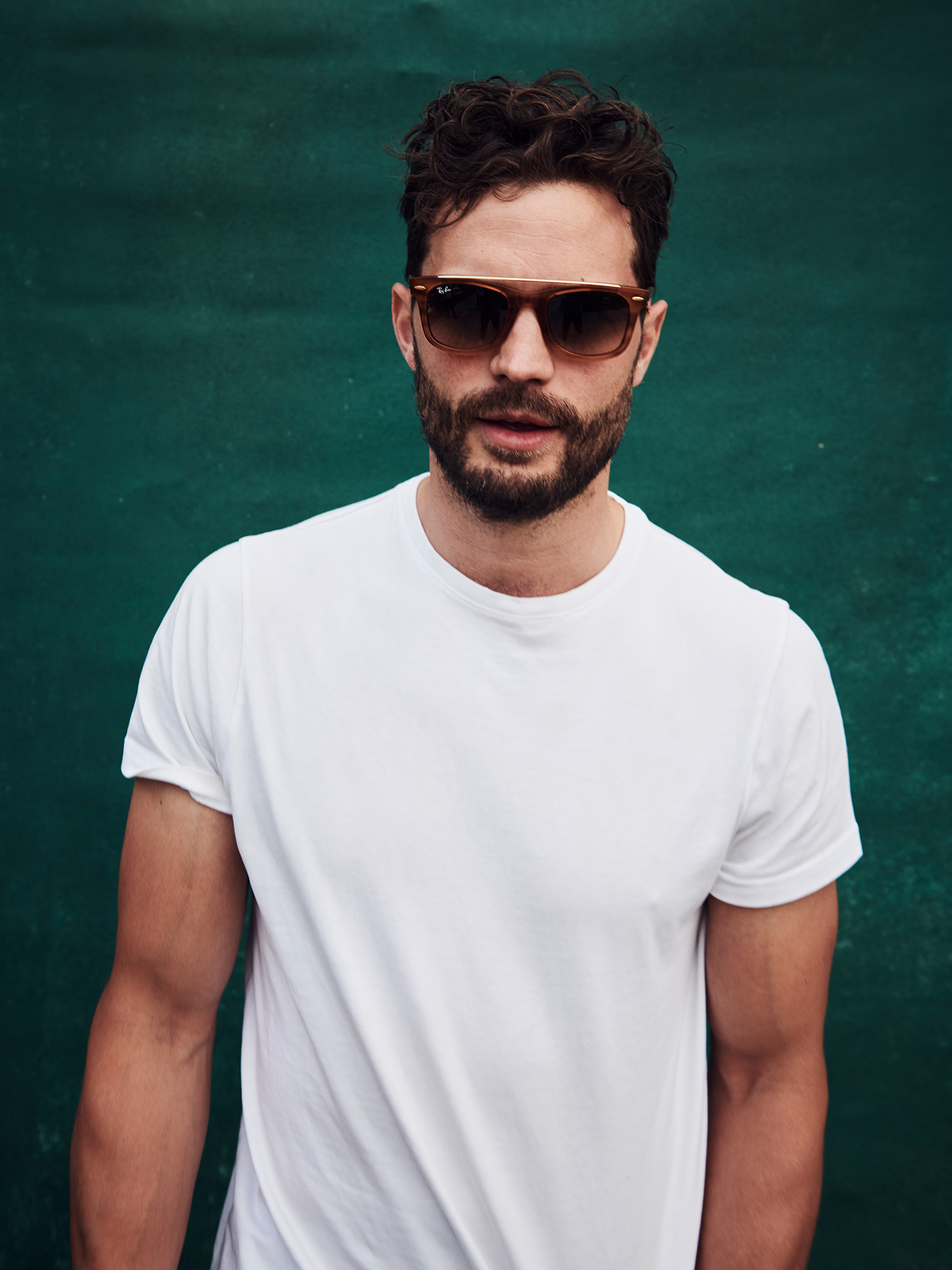 LONDON, UNITED KINGDOM - MAY 24: In this handout image supplied by Ray-Ban, Jamie Dornan wearing Ray-Ban pose at the Ray-Ban Studios during All Points East Festival at Victoria Park on May 24, 2019 in London, England. (Photo by Joe Quigg/Ray-Ban via Getty Images)