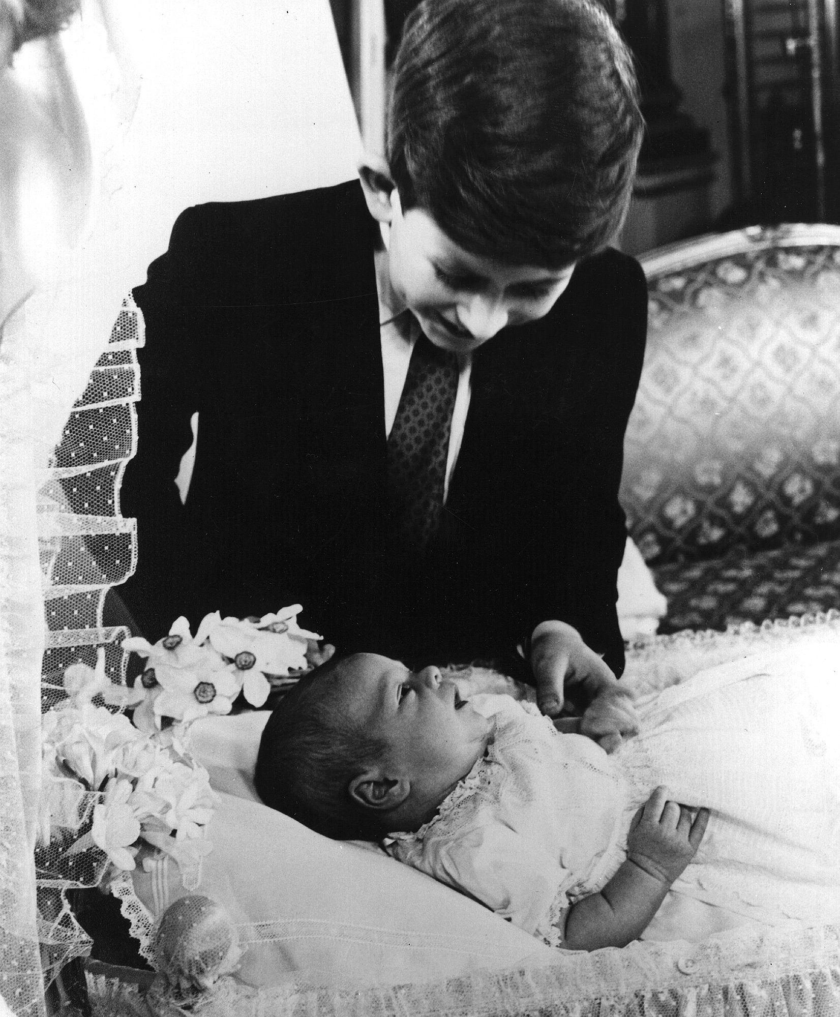 Prince Charles admiring his baby brother, Prince Andrew