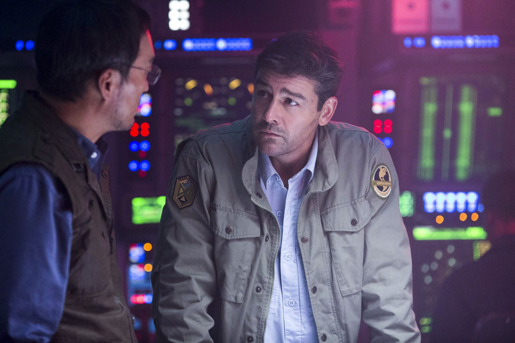 """GODZILLA: KING OF THE MONSTERS Copyright: © 2019 WARNER BROS. ENTERTAINMENT INC. AND LEGENDARY PICTURES PRODUCTIONS, LLC Photo Credit: Daniel McFadden Caption: (L-R) KEN WATANABE as Dr. Ishiro Serizawa and KYLE CHANDLER as Dr. Mark Russell in Warner Bros. Pictures' and Legendary Pictures' action adventure """"GODZILLA: KING OF THE MONSTERS,"""" a Warner Bros. Pictures release."""