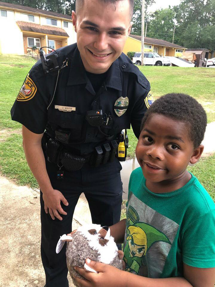 Officer Joe White & his new friend who called 911 without his mom knowing.