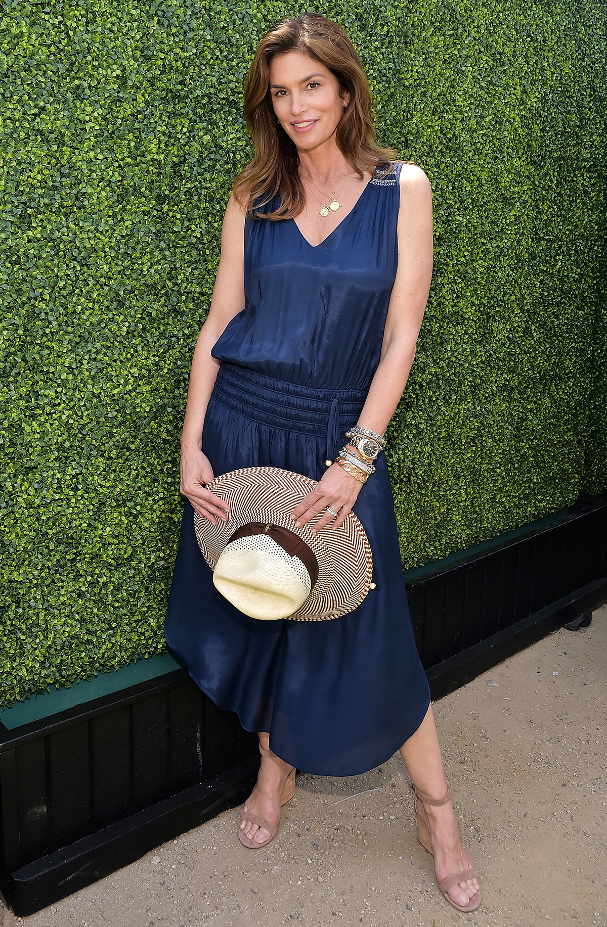 Our Celebrity Muse: Cindy Crawford in a Ramy Brook dress, Borsalino hat and Gianvito Rossi shoes