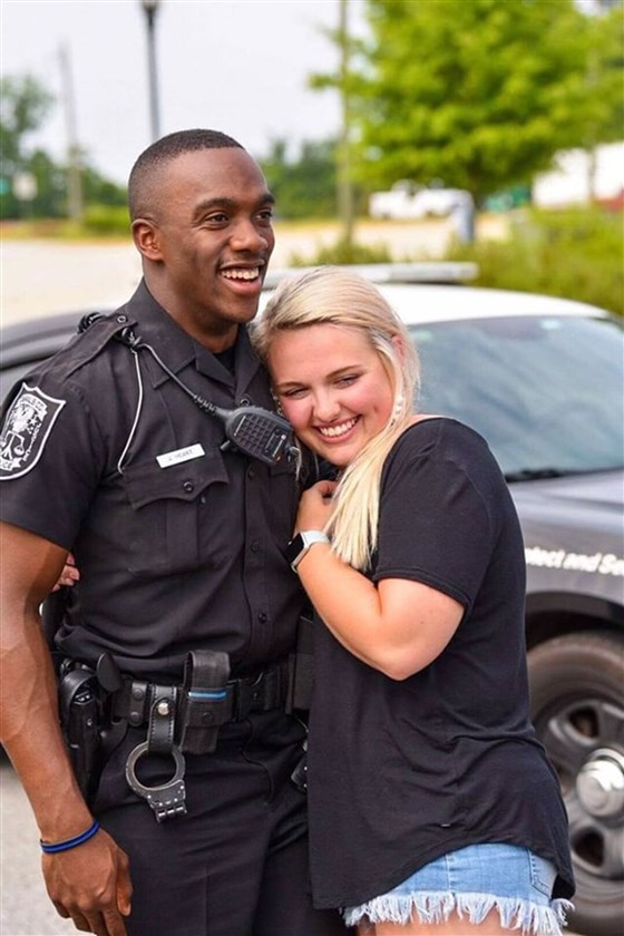 Police officer surprises girlfriend with proposal.