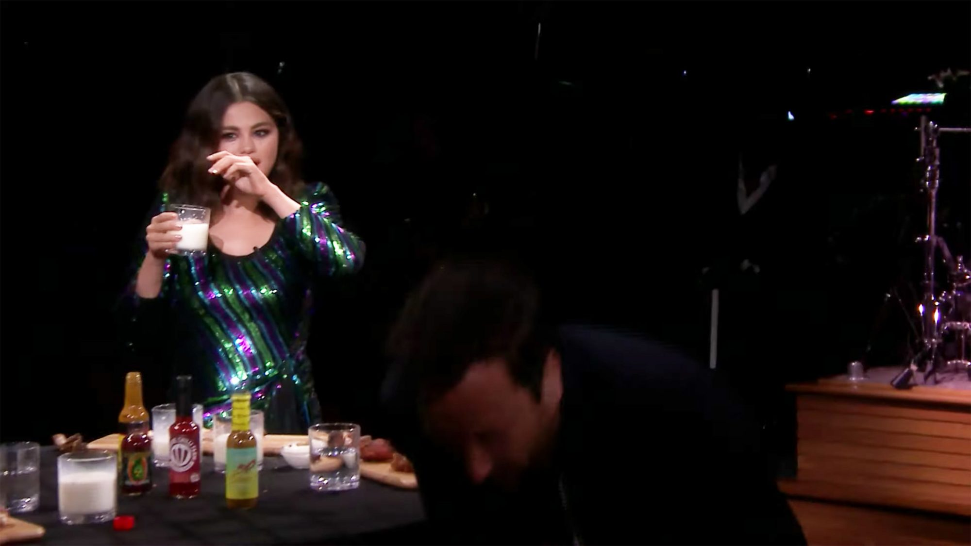 "Jimmy Fallon and singer Selena Gomez during ""Hot Ones"""