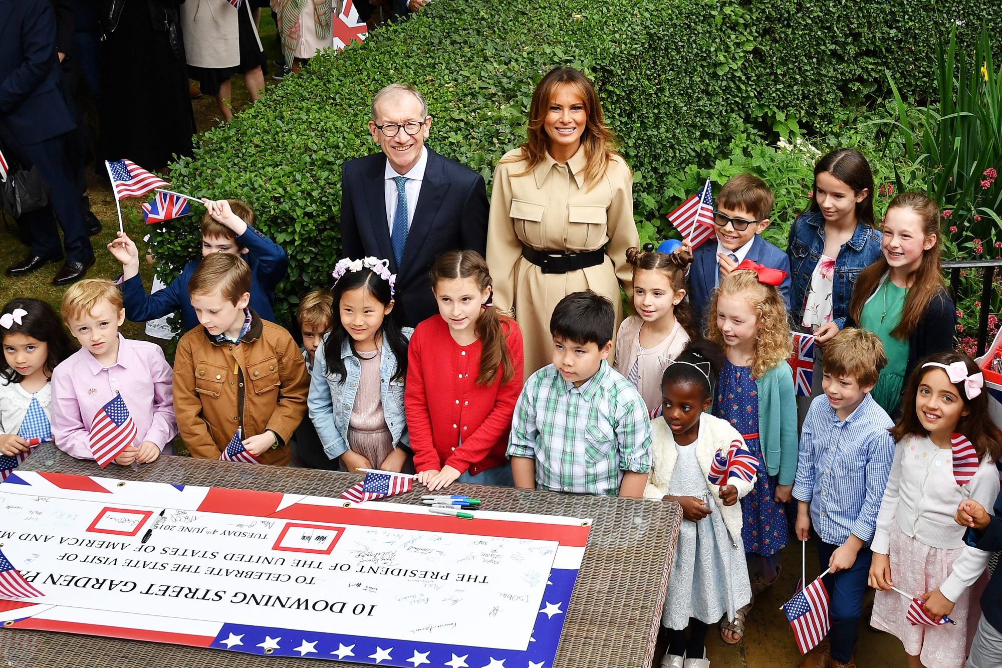 Philip May and First Lady Melania Trump attend a garden party for families of staff from No.10 and the US Embassy in London, at 10 Downing Street, during the second day of President Trump's State Visit on June 4, 2019 in London, England. President Trump's three-day state visit began with lunch with the Queen, followed by a State Banquet at Buckingham Palace, whilst today he will attend business meetings with the Prime Minister and the Duke of York, before travelling to Portsmouth to mark the 75th anniversary of the D-Day landings.