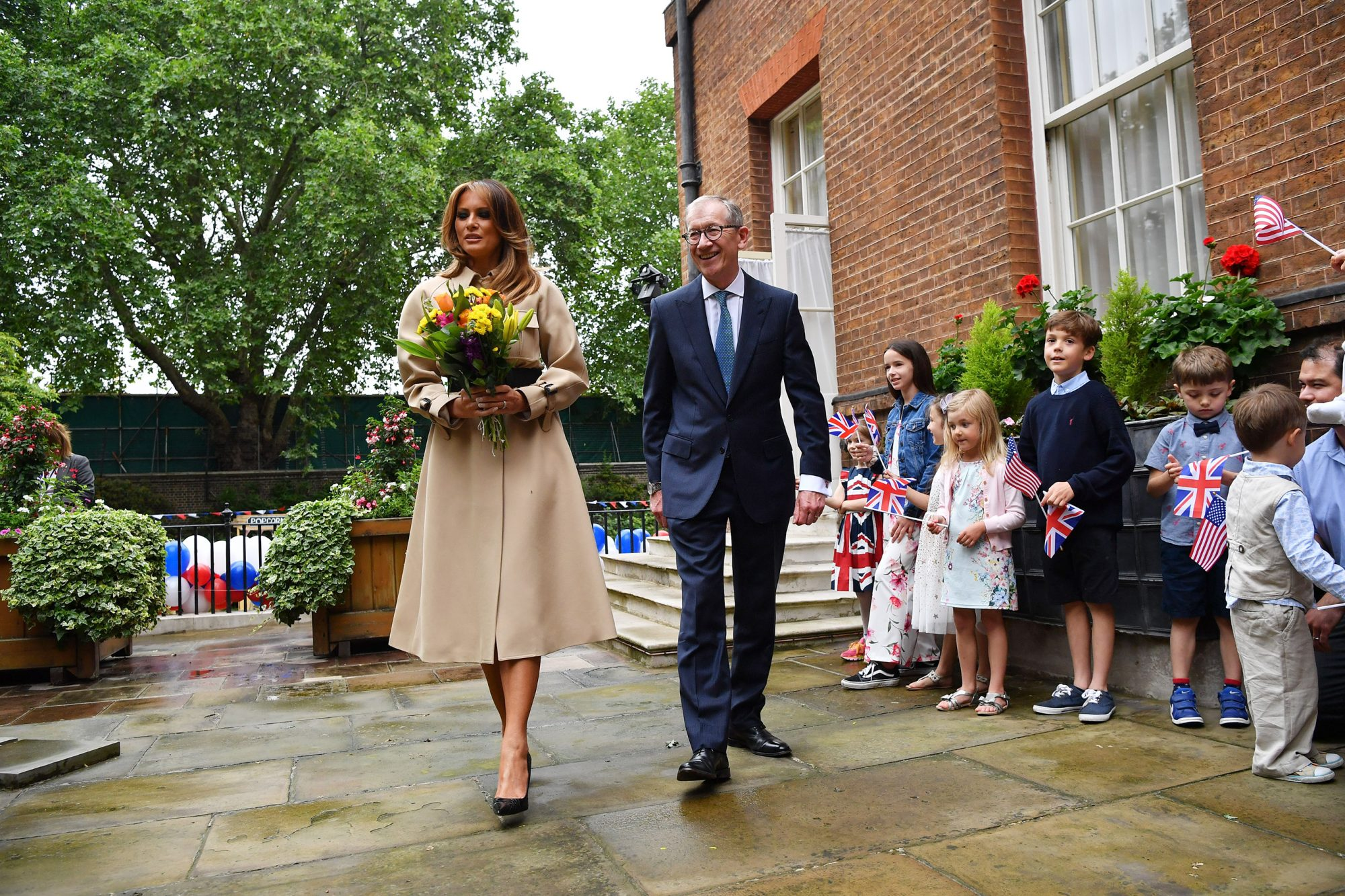 First Lady Melania Trump (L) and Philip May (R), husband of Britain's Prime Minister Theresa May