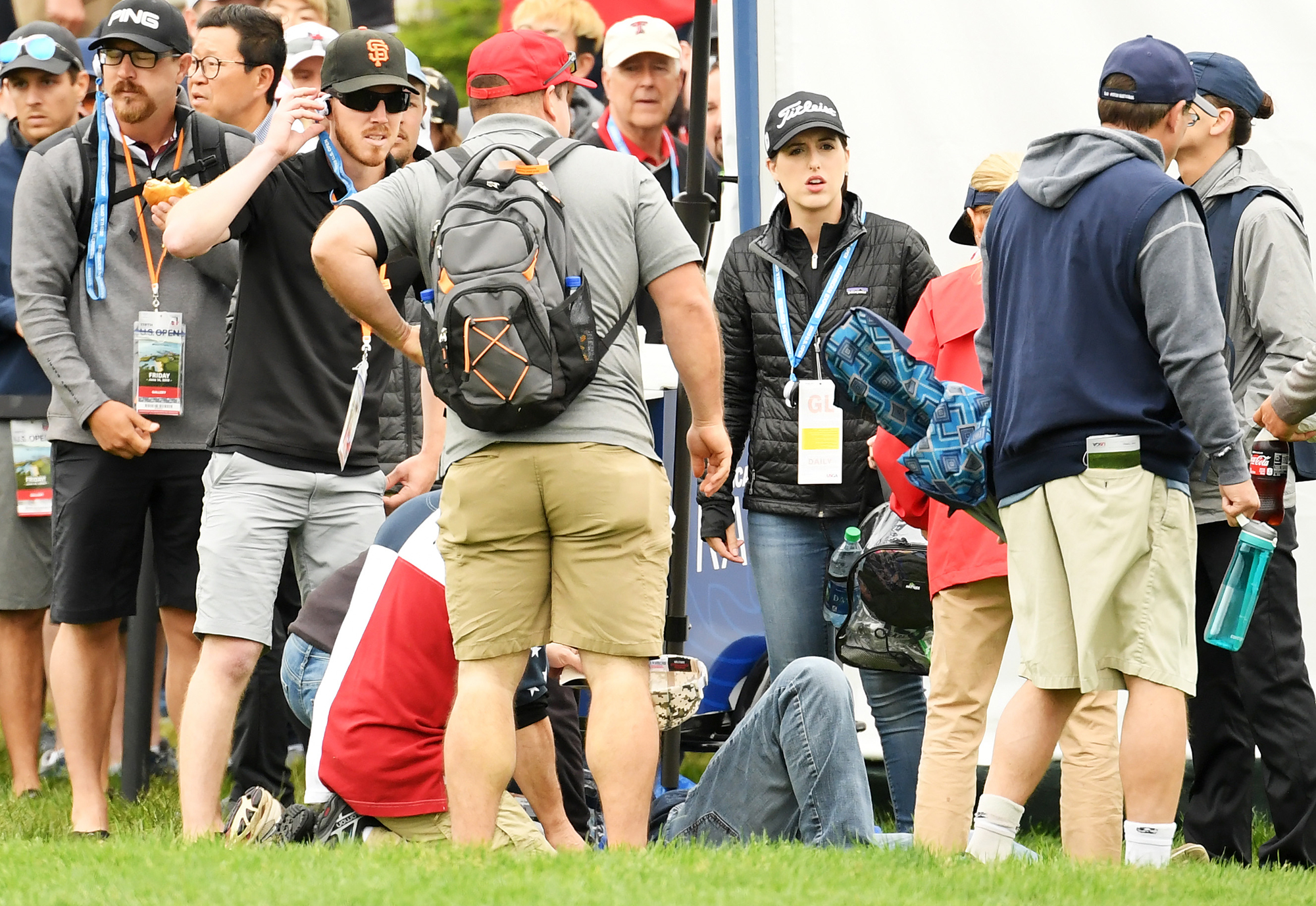 Medical attention is administered after an incident involving a golf cart on the 16th hole during the second round of the 2019 U.S. Open