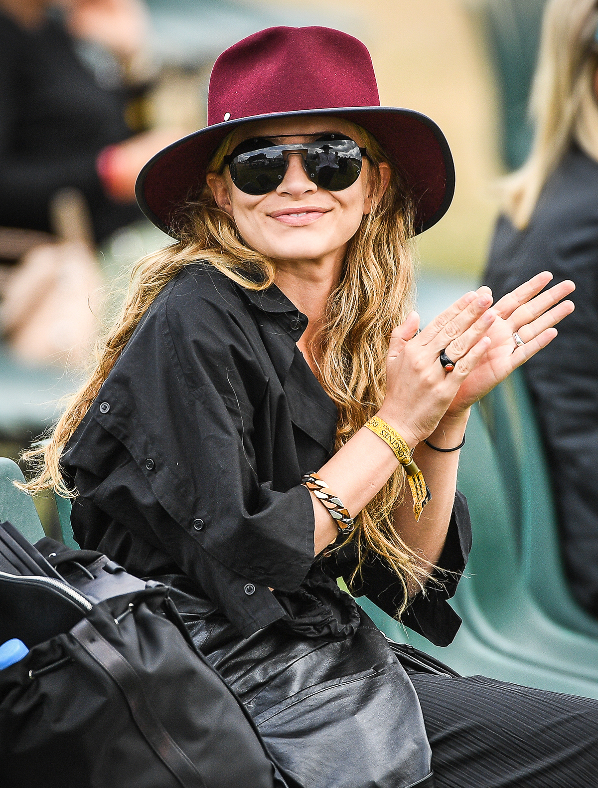 Ashley Olsen seen on a break, and smoking a cigarette after riding Fatum during the Longines Global Champions Tour at Chantilly. Twin sister Ashley Olsen was seen later in the afternoon wearing a dark red hat and matching sunglasses