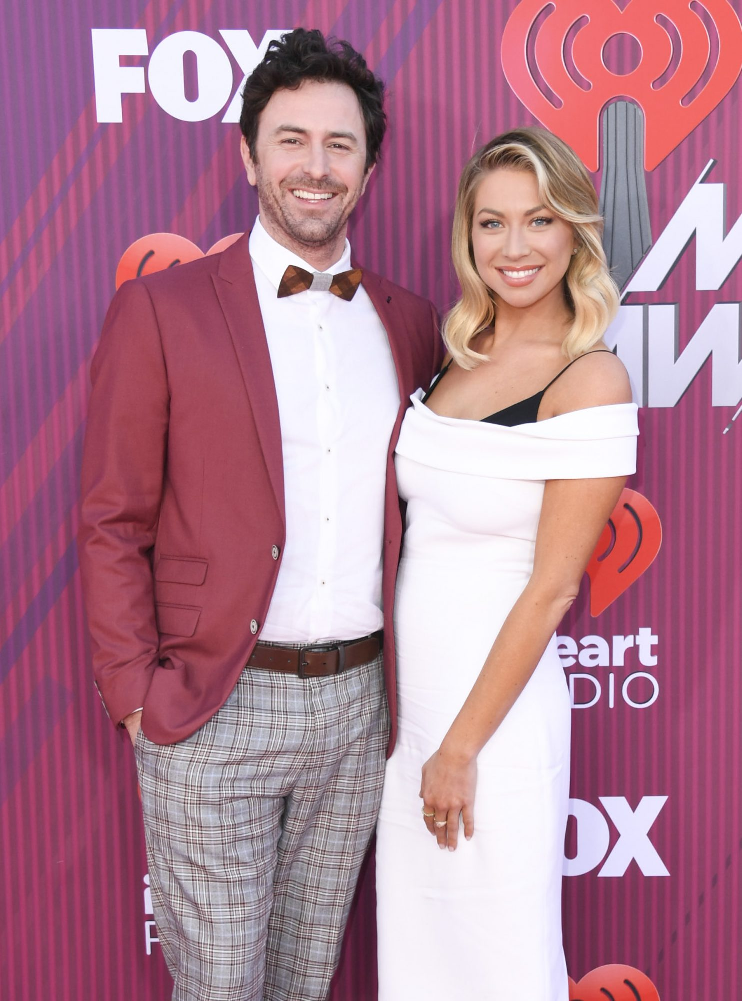 LOS ANGELES, CALIFORNIA - MARCH 14: Beau Clark and Stassi Schroeder arrive at the 2019 iHeartRadio Music Awards which broadcasted live on FOX at Microsoft Theater on March 14, 2019 in Los Angeles, California. (Photo by Jon Kopaloff/FilmMagic)