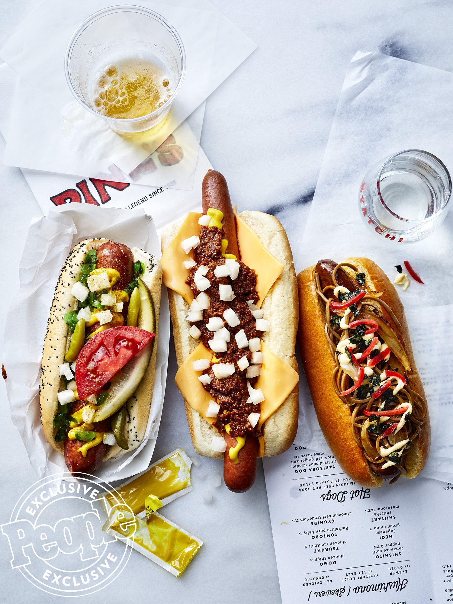 Food Travel - People Food - PInk's -Chili Cheese DogKyatchi's Yakosoba Dog topped with stir fried soba noodles and Japanese mayoMike's Hot DogsChicago-style dog with as pickle spear
