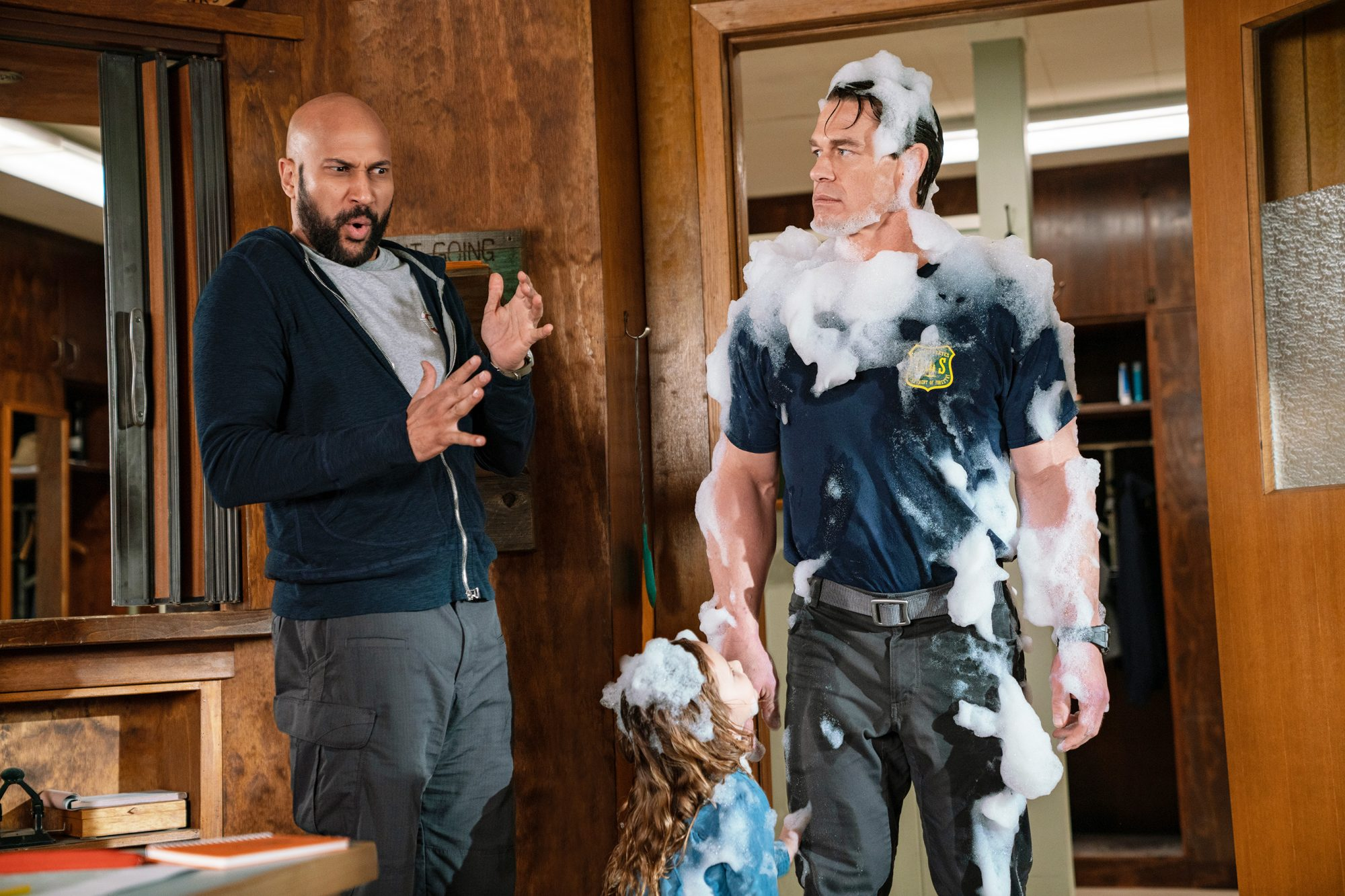L-R: Keegan-Michael Key, Finley Rose Slater, and John Cena in PLAYING WITH FIRE from Paramount Pictures. Photo Credit: Doane Gregory.
