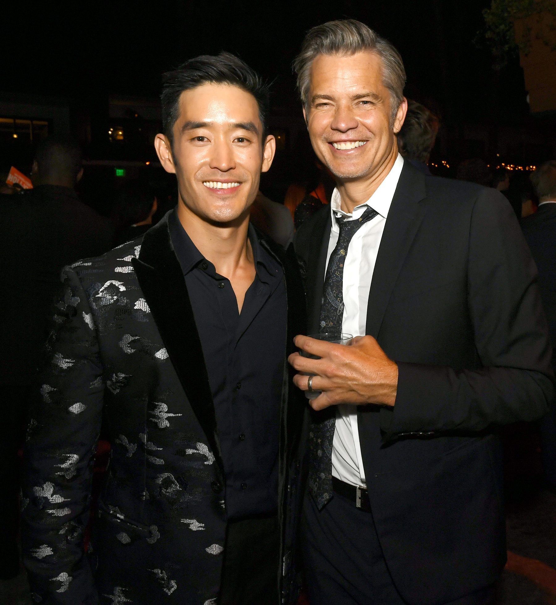 Mike Moh (L) and Timothy Olyphant