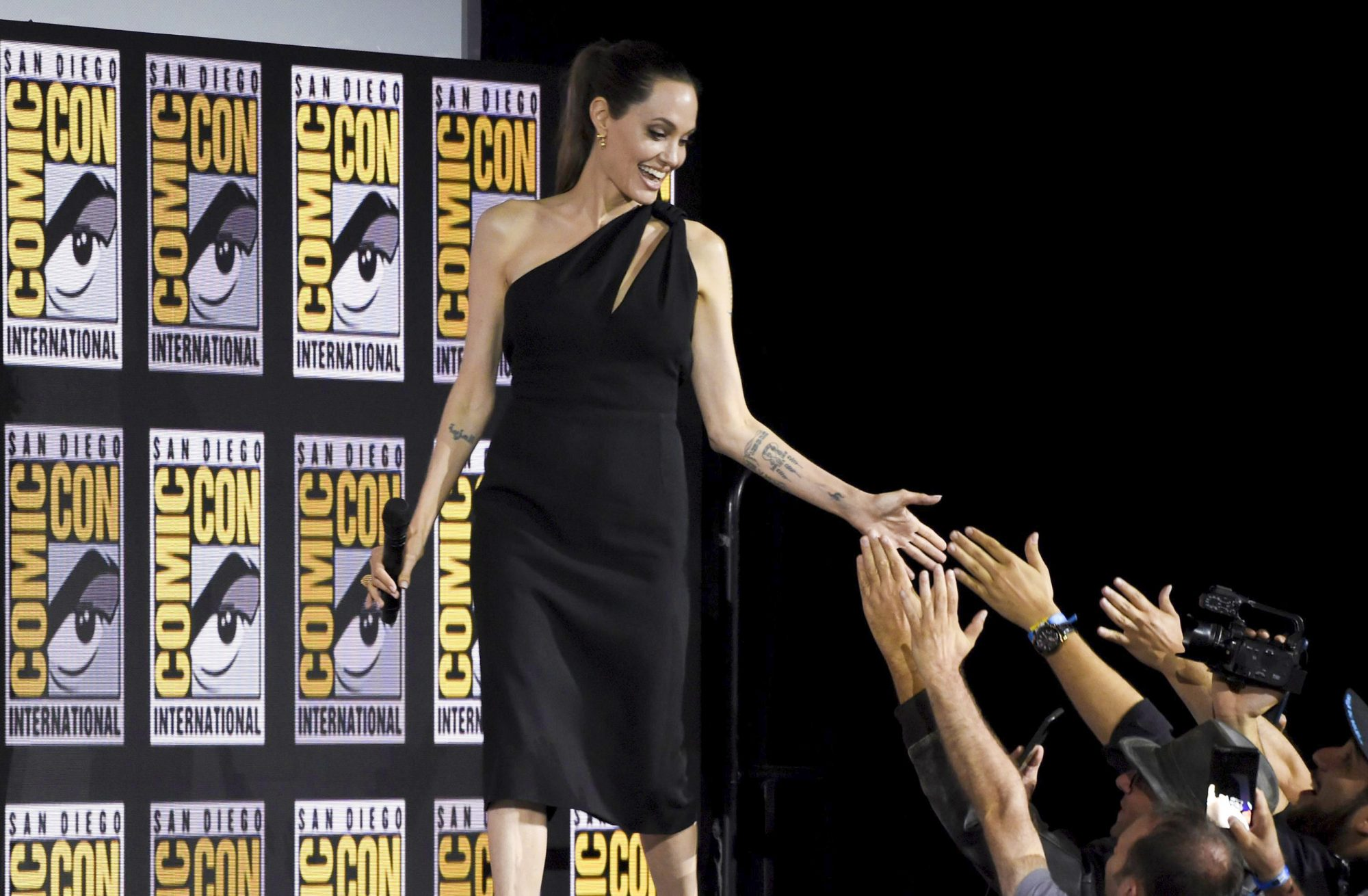 Mandatory Credit: Photo by Chris Pizzello/Invision/AP/Shutterstock (10342690a) Angelina Jolie greets fans as she walks on stage at the Marvel Studios panel on day three of Comic-Con International, in San Diego 2019 Comic-Con - Marvel Studios, San Diego, USA - 20 Jul 2019