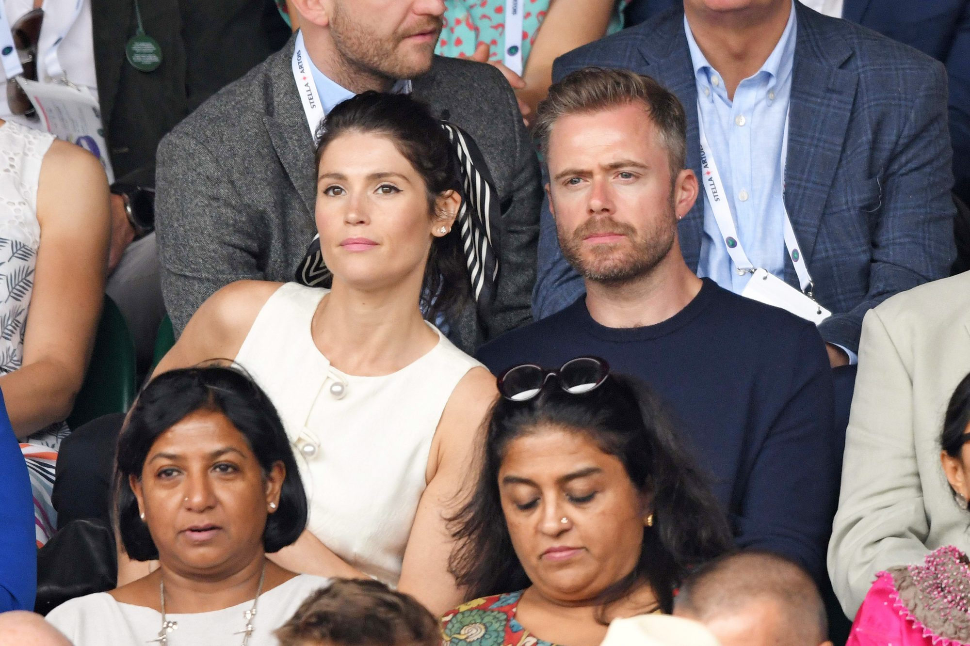 LONDON, ENGLAND - JULY 14: Gemma Arterton and Rory Keenan on Centre Court on Men's Finals Day of the Wimbledon Tennis Championships at All England Lawn Tennis and Croquet Club on July 14, 2019 in London, England. (Photo by Karwai Tang/Getty Images)
