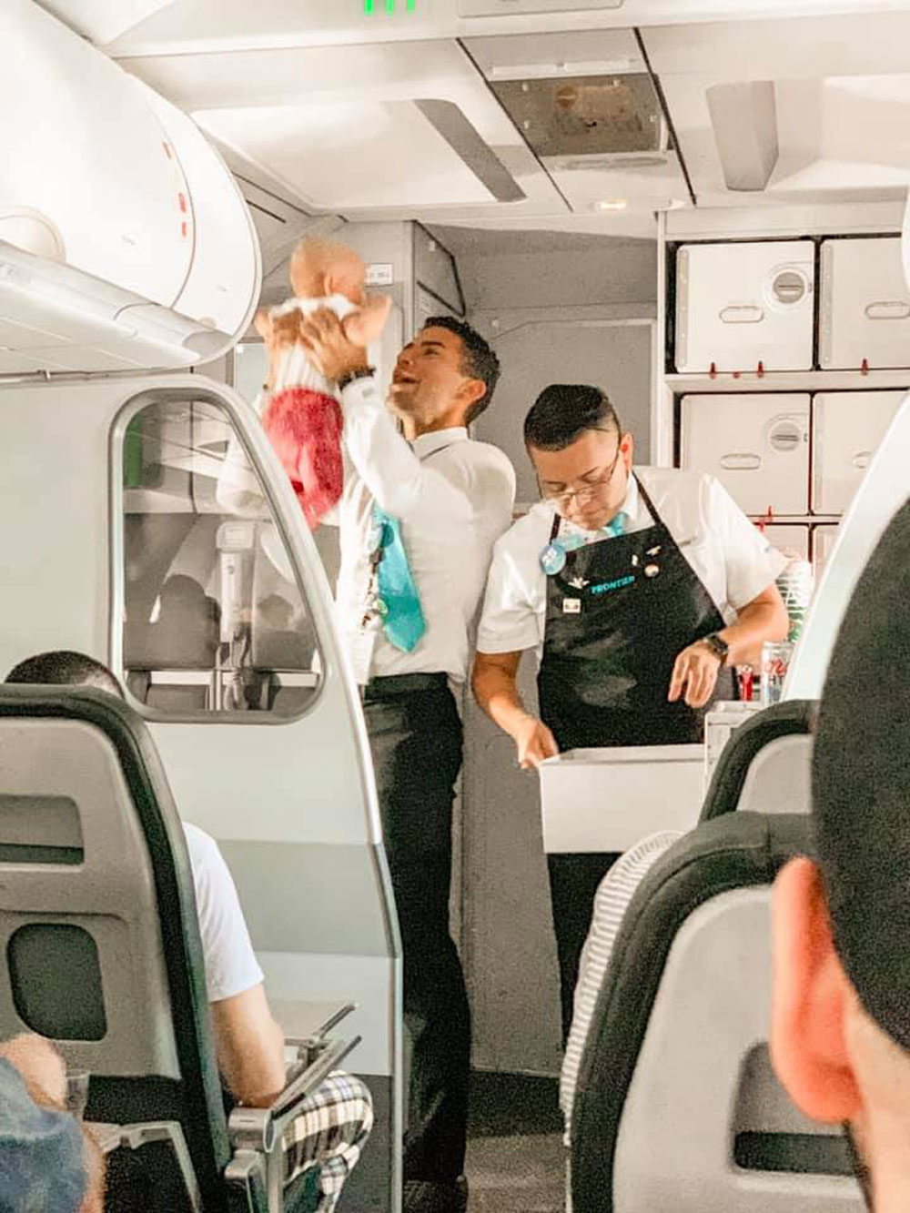 flight attendant comforted a woman's crying baby