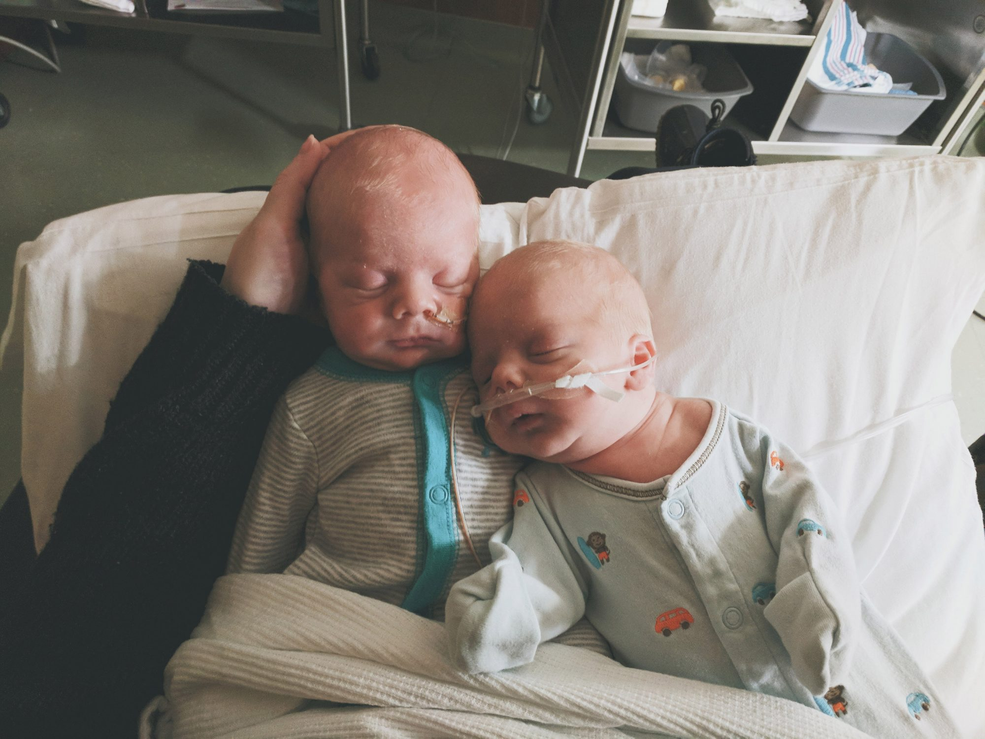 Argon and Aldridge. See SWNS story SWNYsun; A set of parents moved their family-of-nine almost 3000 miles to protect their albino toddlers from the sun's damaging UV rays. Ally and Ryan McNallen decided to move their seven children from the desert to the mountains to help give their identical twin sons Aldridge and Argon, 18 months, a better quality of life. The white-haired, fair-skinned twins were diagnosed with albinism in summer 2018, a condition in which their skin, hair and eyes lack melanin pigment.