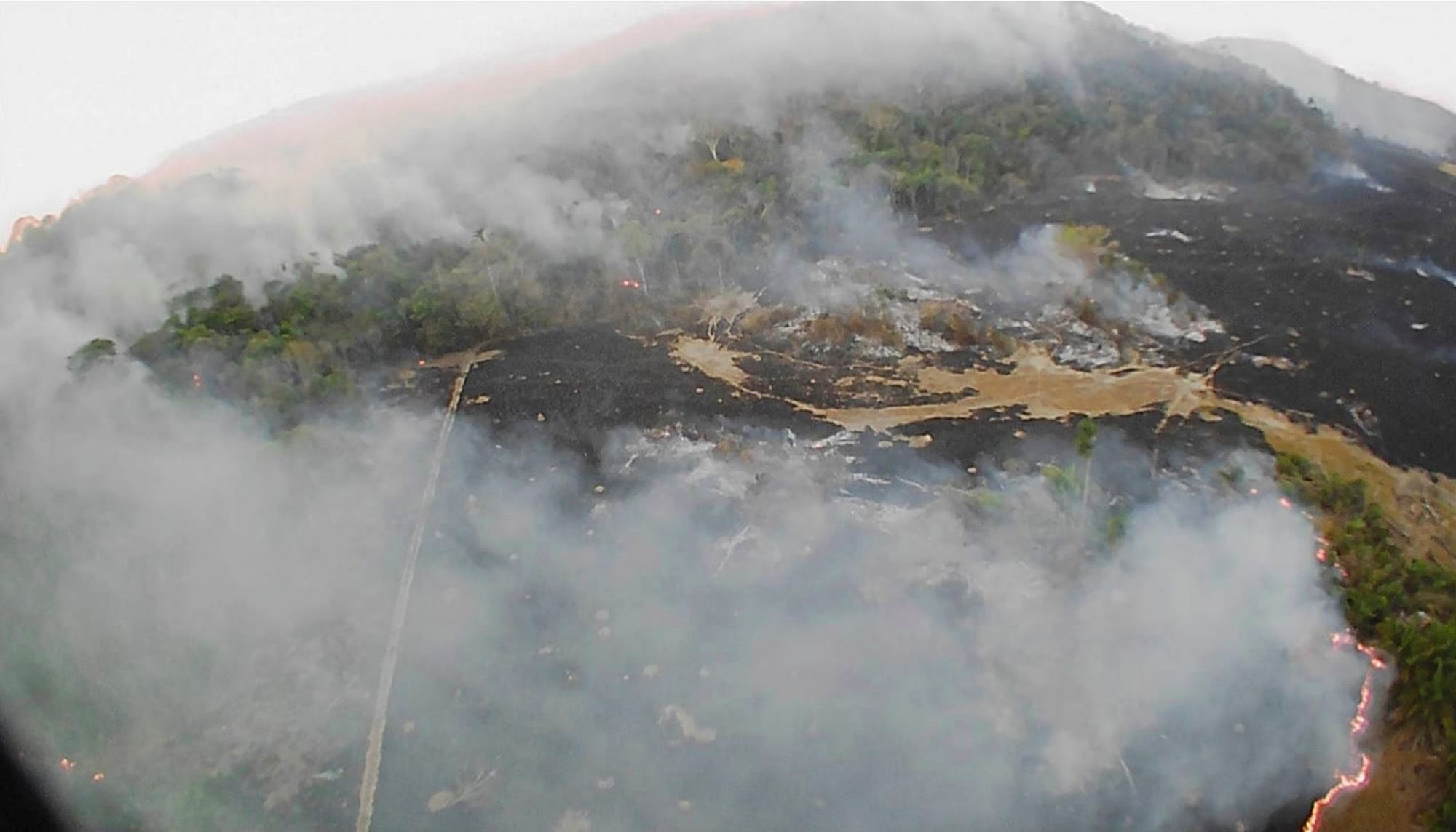 In this drone photo released by the Corpo de Bombeiros de Mato Grosso, brush fires burn in Guaranta do Norte municipality, Mato Grosso state, Brazil. Brazil's National Institute for Space Research, a federal agency monitoring deforestation and wildfires, said the country has seen a record number of wildfires this year Environment, Guaranta do Norte, Brazil - 20 Aug 2019