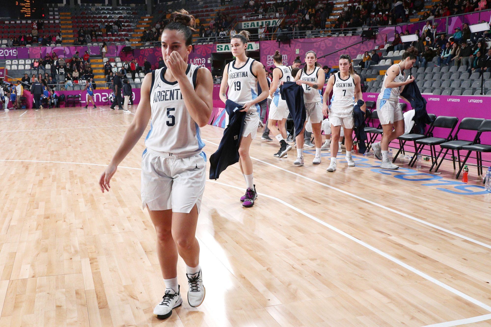 Players of Argentina leaves the court at the end of the first half during the women's basketball match against the Virgin Islands at the Pan American Games in Lima, Peru, Thursday, Aug. 8, 2019.