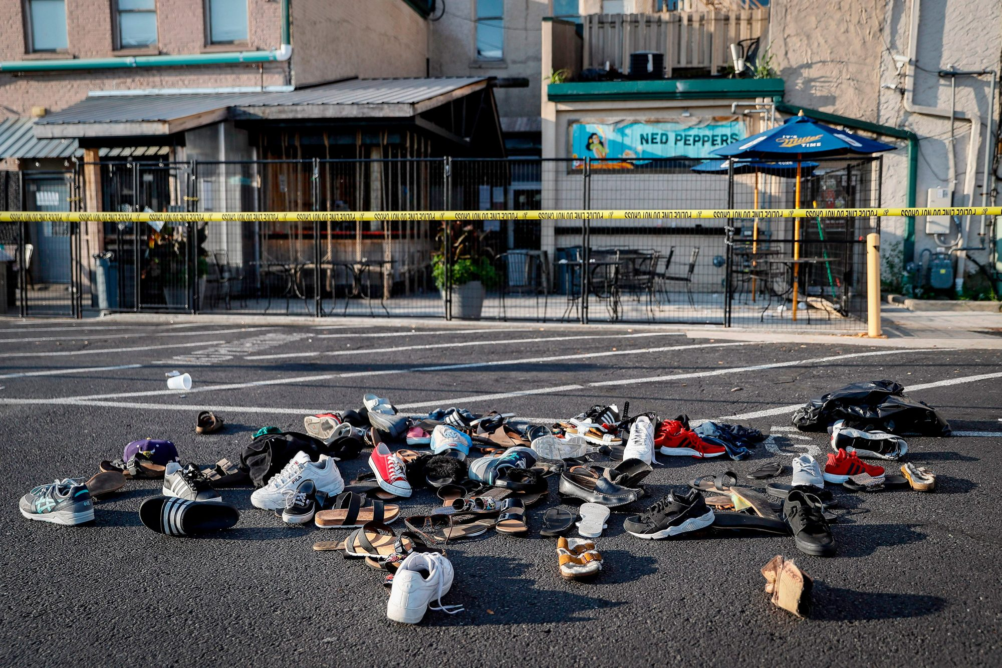 Shoes are piled outside the scene of a mass shooting including Ned Peppers bar, in Dayton, Ohio