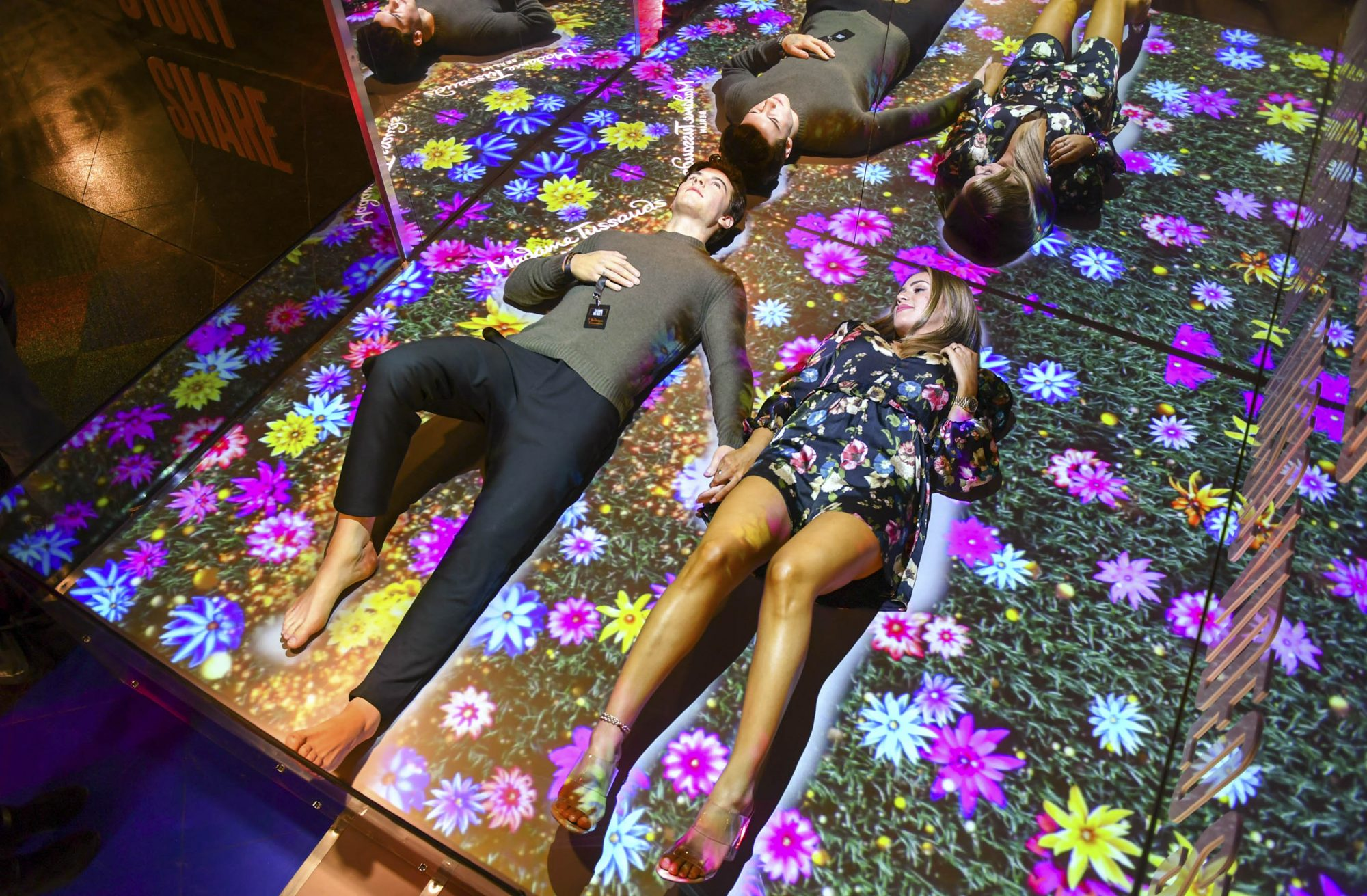 """14 August 2019, Berlin: Bachelorette Jessica Paszka lies next to the wax figure of the singer Shawn Mendes in the wax figure cabinet Madame Tussauds. The wax figure of Mendes can now be seen here and fans can take photos with the figure. Shawn Mendes sings with """"Senorita"""" the summer hit of the year 2019. Photo: Jens Kalaene/dpa-Zentralbild/dpa (Photo by Jens Kalaene/picture alliance via Getty Images)"""
