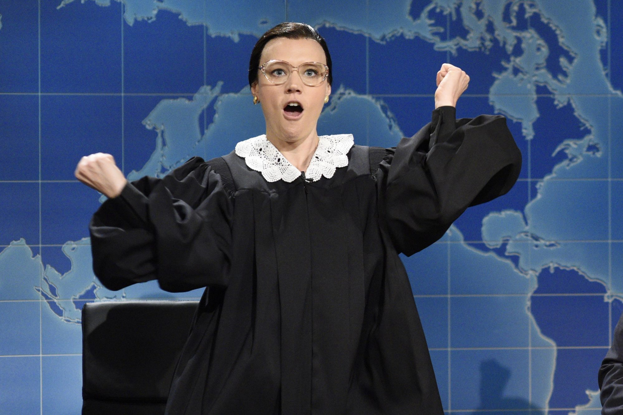 """SATURDAY NIGHT LIVE -- """"Gal Gadot"""" Episode 1727 -- Pictured: (l-r) Kate McKinnon as Ruth Bader Ginsburg Associate Justice of the Supreme Court of the United States, Colin Jost, Michael Che during """"Weekend Update"""" in Studio 8H on October 7, 2017 -- (Photo by: Will Heath/NBC/NBCU Photo Bank via Getty Images)"""