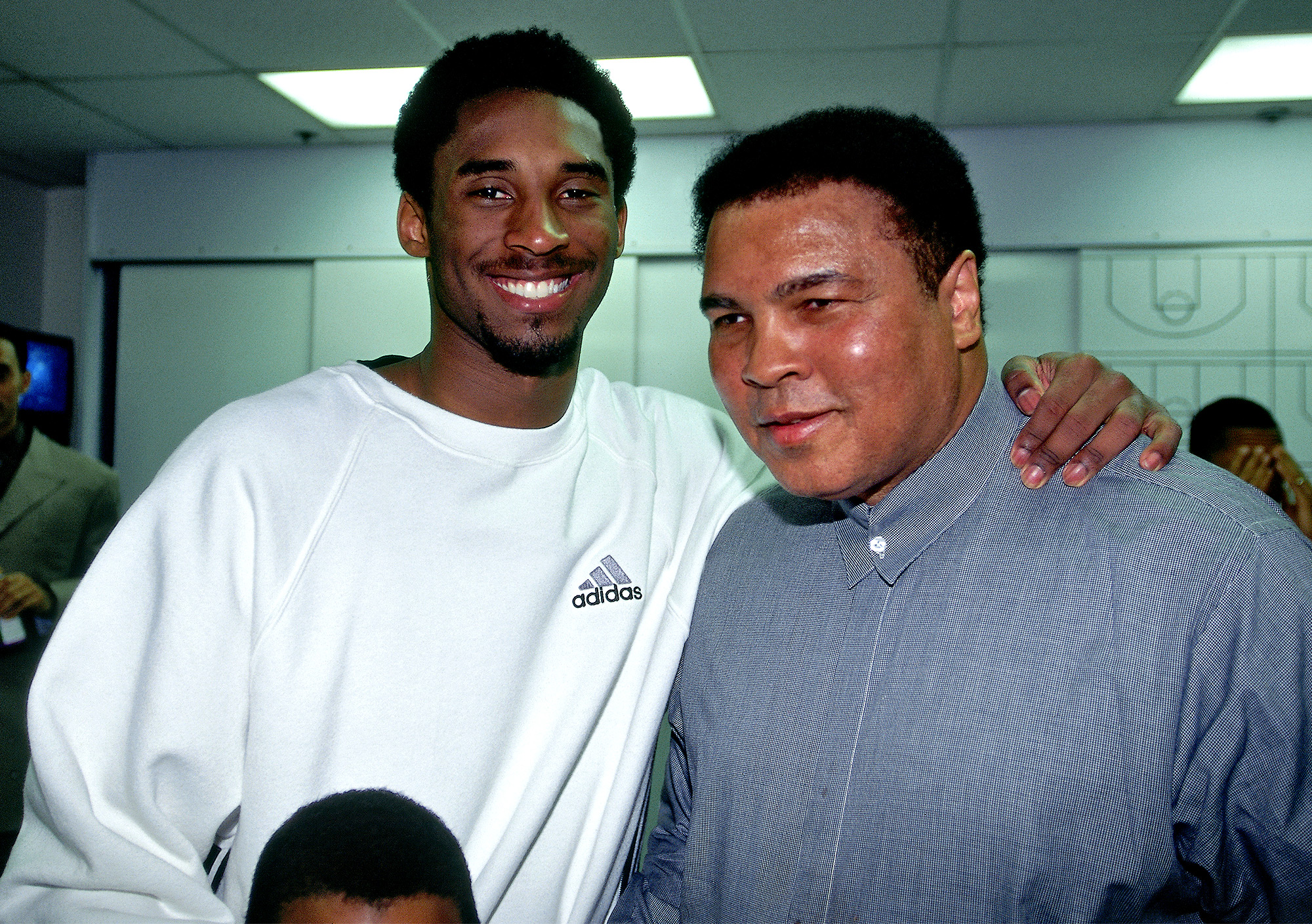 Kobe Bryant #8 of the Los Angeles Lakers poses with Mohammad Ali