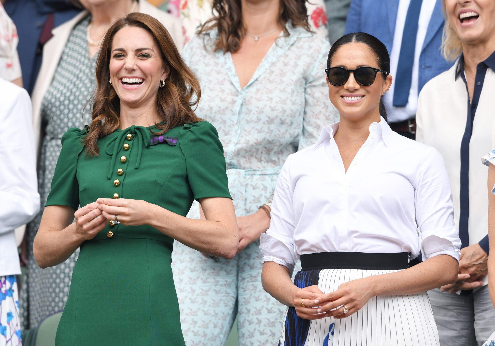 LONDON, ENGLAND - JULY 13: Catherine, Duchess of Cambridge and Meghan, Duchess of Sussex in the Royal Box on Centre Court during day twelve of the Wimbledon Tennis Championships at All England Lawn Tennis and Croquet Club on July 13, 2019 in London, England.