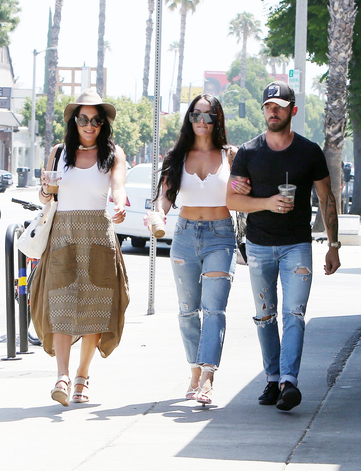 Nikki Bella and Artem Chigvintsev are joined by sister Brie Bella