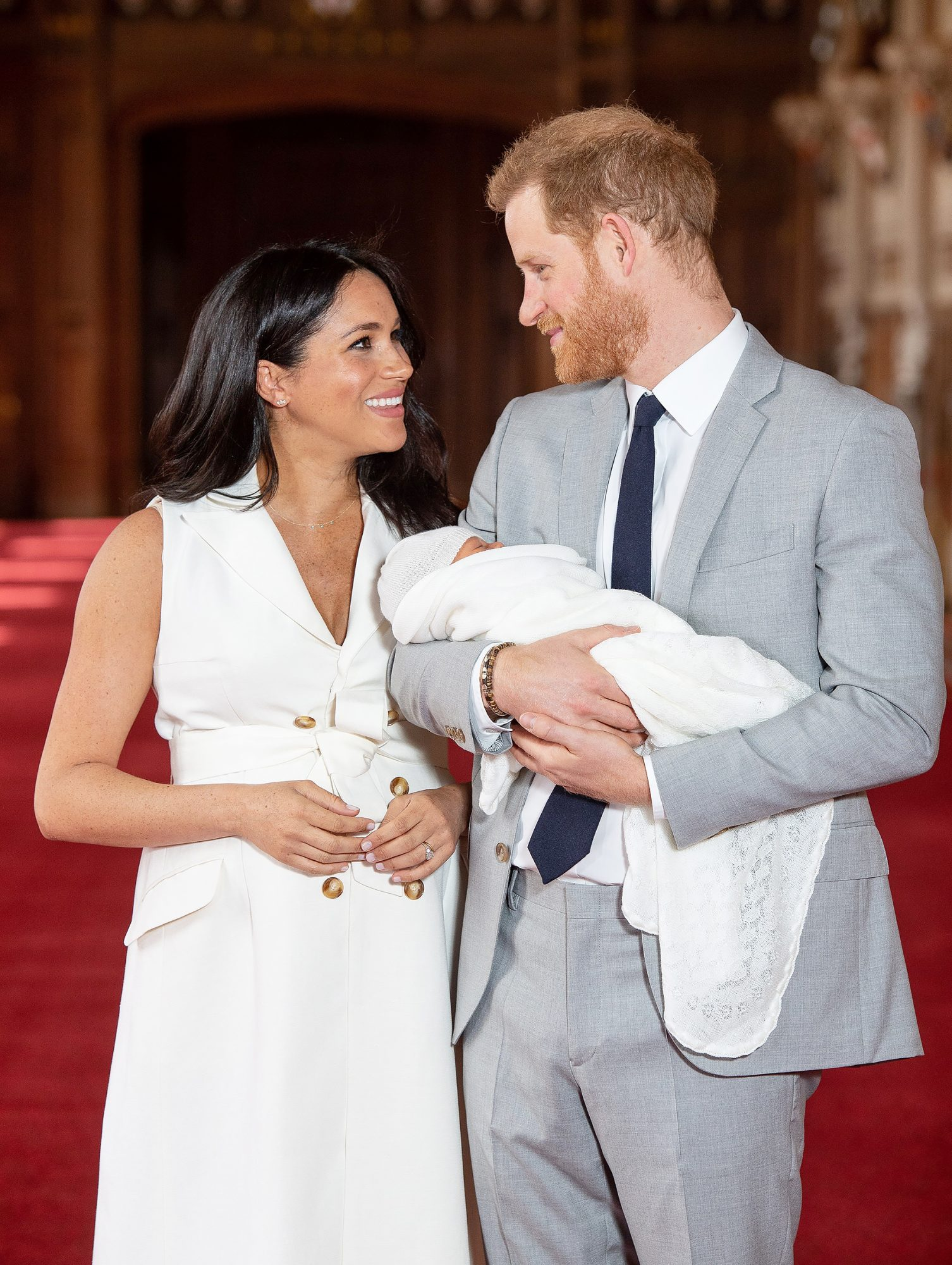 Britain's Prince Harry, Duke of Sussex (R), and his wife Meghan, Duchess of Sussex, pose for a photo with their newborn baby son in St George's Hall at Windsor Castle in Windsor, west of London on May 8, 2019. (Photo by Dominic Lipinski / POOL / AFP) (Photo credit should read DOMINIC LIPINSKI/AFP/Getty Images)