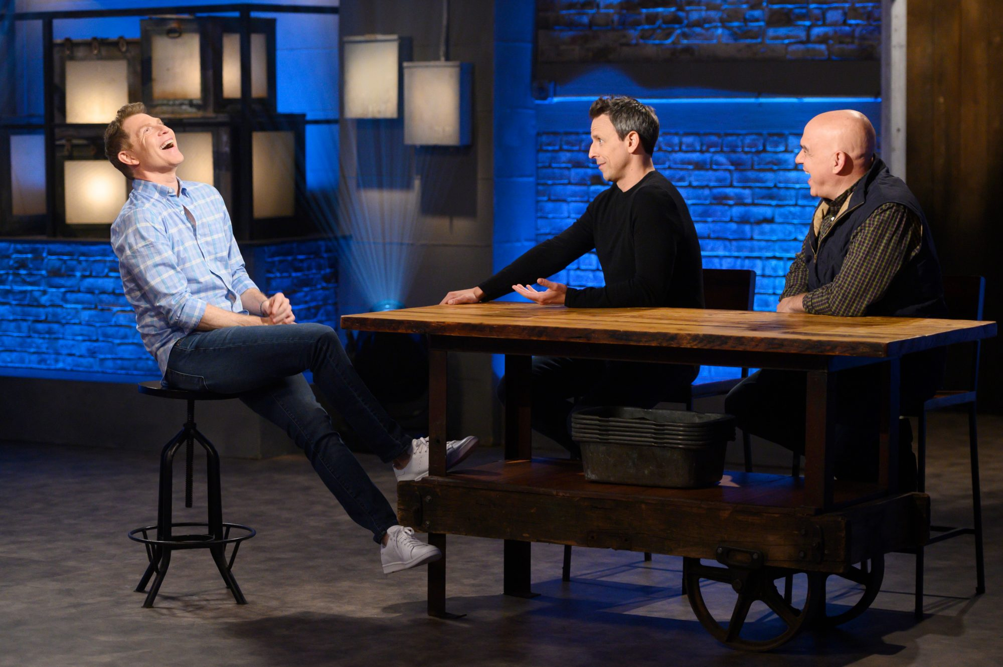 Host Bobby Flay with co-hosts Seth Meyers and Michael Symon