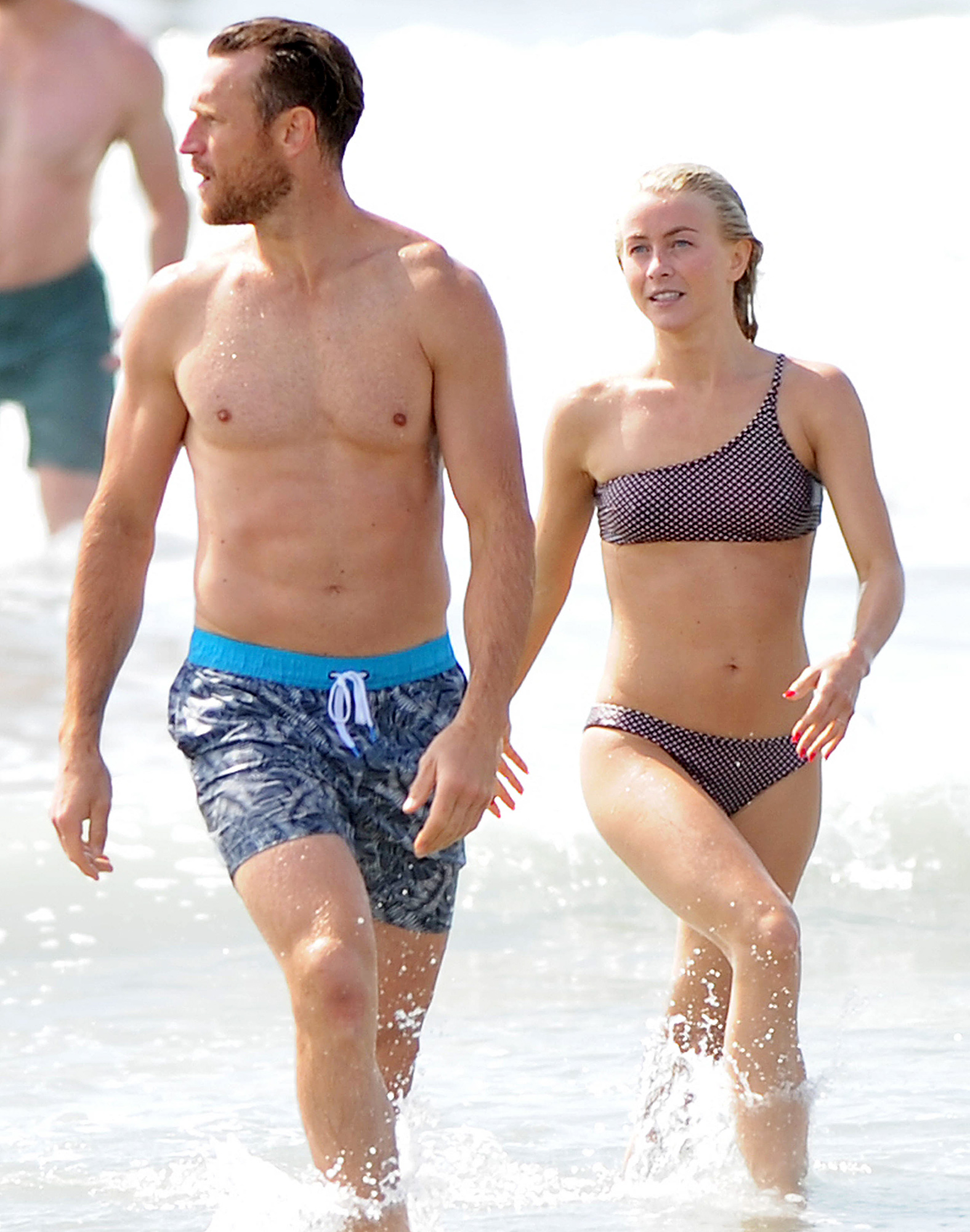 Julianne Hough slips into a bikini while bodysurfing with husband Brooks Laich at the beach over Labor Day