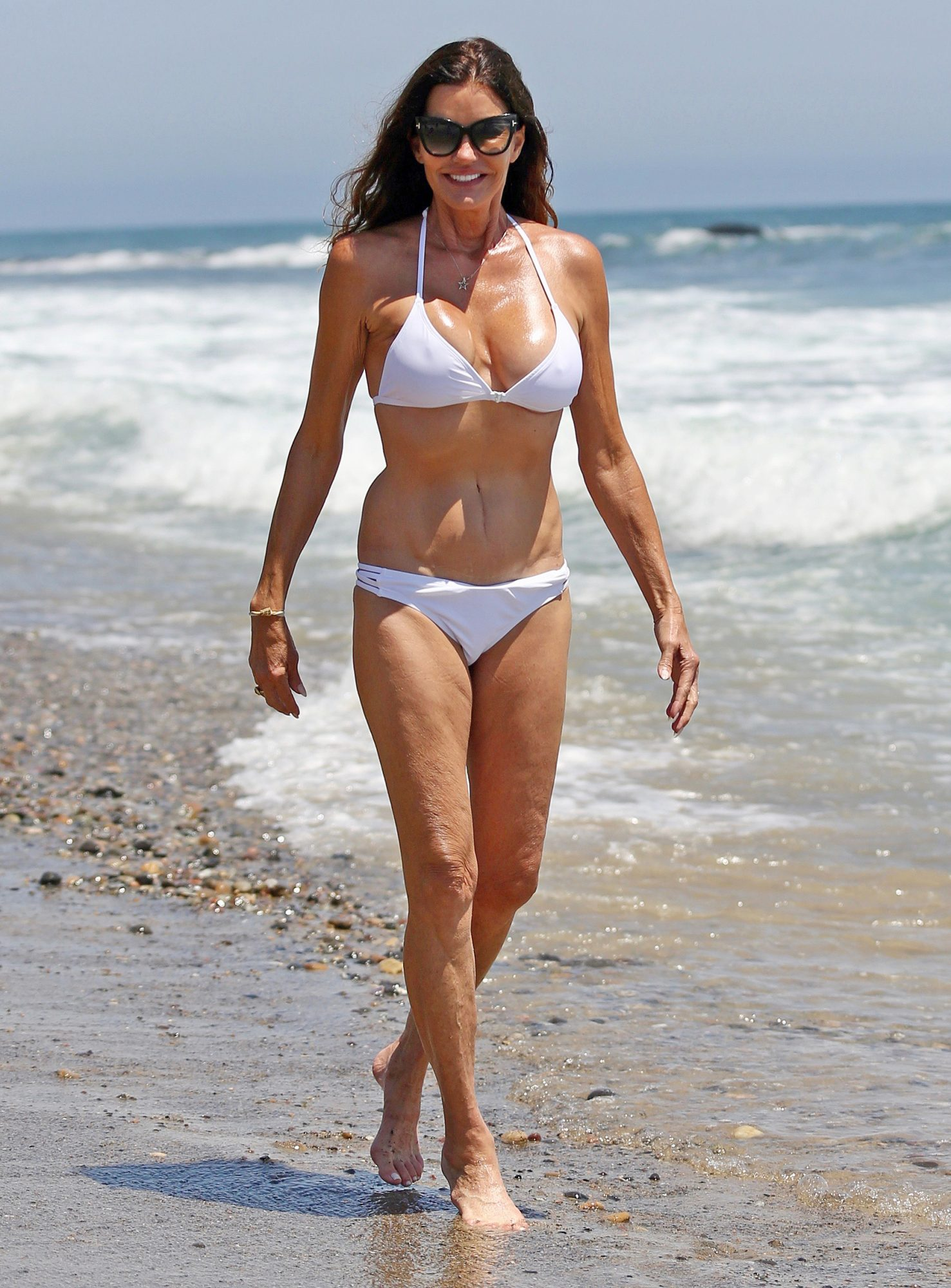 EXCLUSIVE: Janice Dickinson out on the Beach on Independence day in Malibu