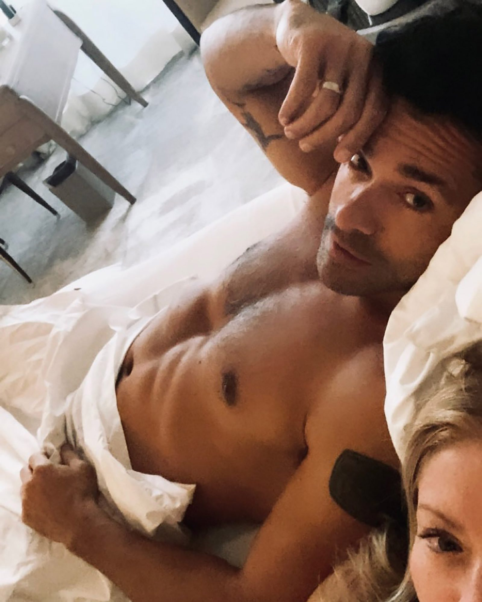 """Kelly isn't shy about posting a """"thirst trappy"""" photo of her hubby in order to promote his work onRiverdale. Not only is it smart promotion, it's proof that they've still got it, 25 years later."""