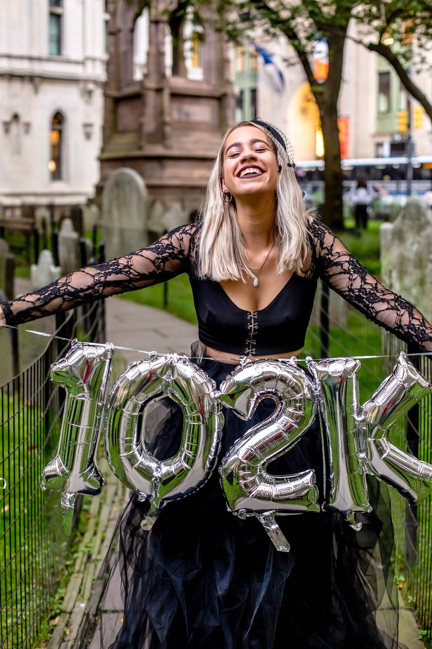 Woman celebrates paying off her student loans with funeral-themed photo shoot