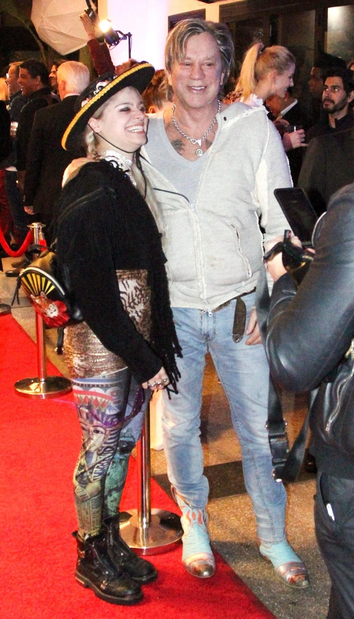 Mickey Rourke attends a celeb Christmas party at Caffe Roma