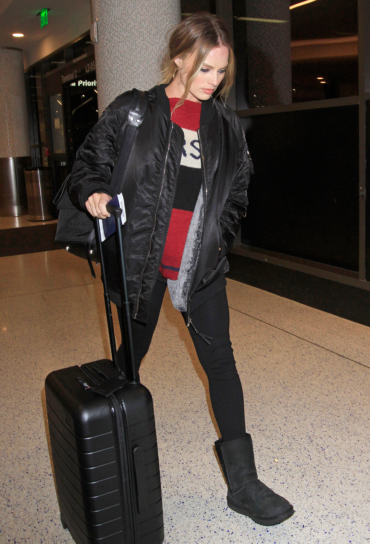 EXCLUSIVE: Margot Robbie makes a casual departure out of Los Angeles with a female friend.  The sexy Australian actress was seen at LAX with a black coat a red, white & black sweater, black leggings & black UGGS.