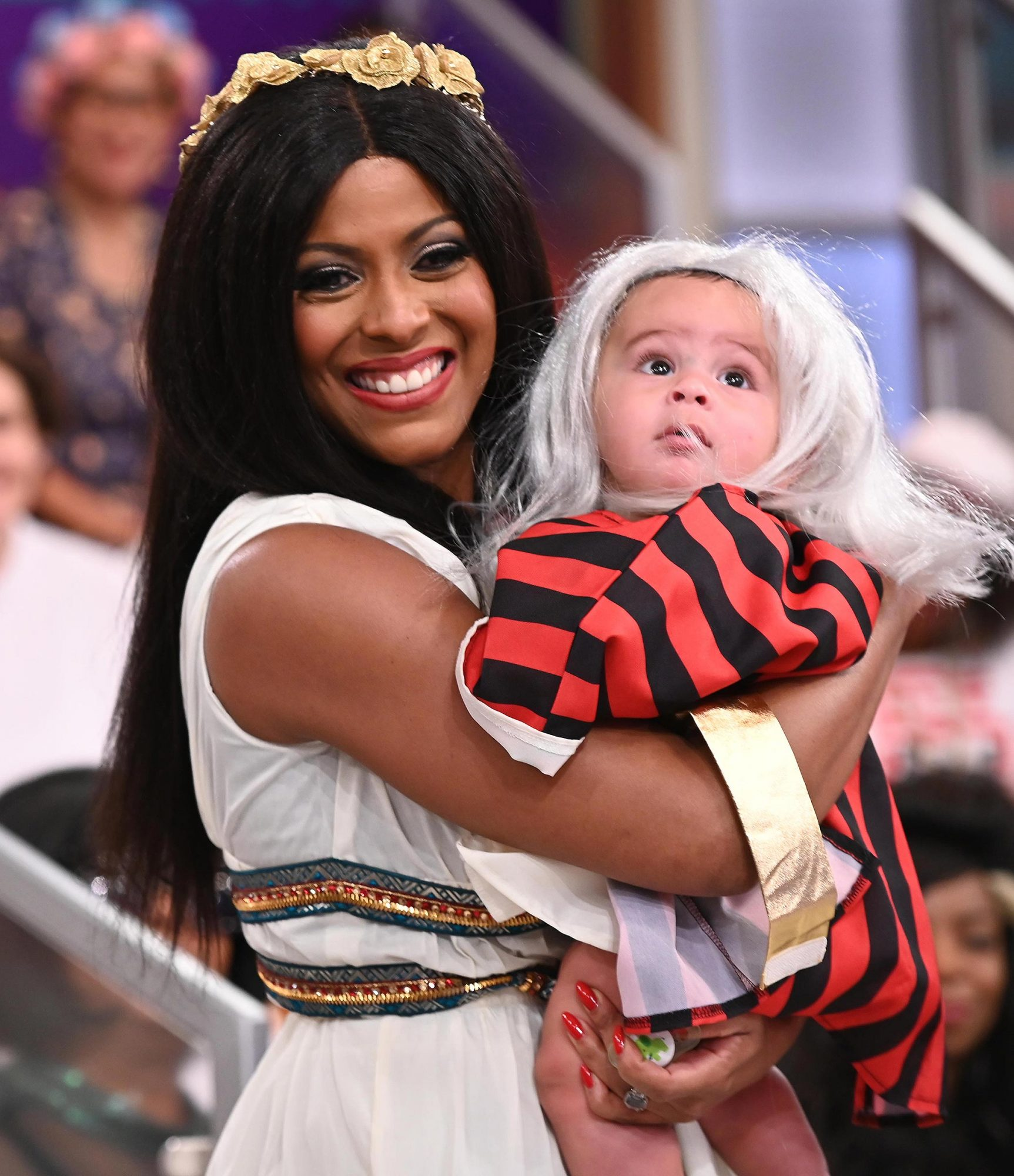 The host of Tamron Hall kicked off her first-ever HALL-o-ween show by making her grand entrace as Dynasty's Dominique Deveraux. Hall also brought out her son Moses, who celebrated his first Halloween dressed as his namesake.