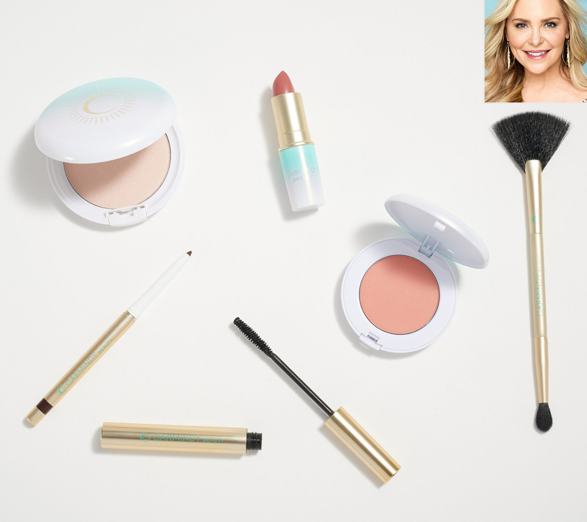 """Carmindy taught thousands of women the basics of beauty as the lead makeup artist on the TLC hit What Not To Wear, and now she's bringing her easy-to-copy makeup tips and tricks to the masses. The beauty pro just launched her new makeup line exclusively with QVC featuring a fool-proof numbered makeup system to take the guess work out of getting ready.                             The first is the """"Carmindizing Skin System Kit"""" which includes a primer, foundation, concealer and powder. And the second is """"The 5-Minute Face"""" which features a shimmery highlighter, an espresso-colored eyeliner, black mascara (in an easy-to-remove formula), a rose tone blush, a pink lipstick and a double-ended highlight brush, each designed in universal shades to complement all skin tones.                             Buy It! Carmindy Beauty 5 Minute Face 5-Piece Collection, $59.50; qvc.com"""